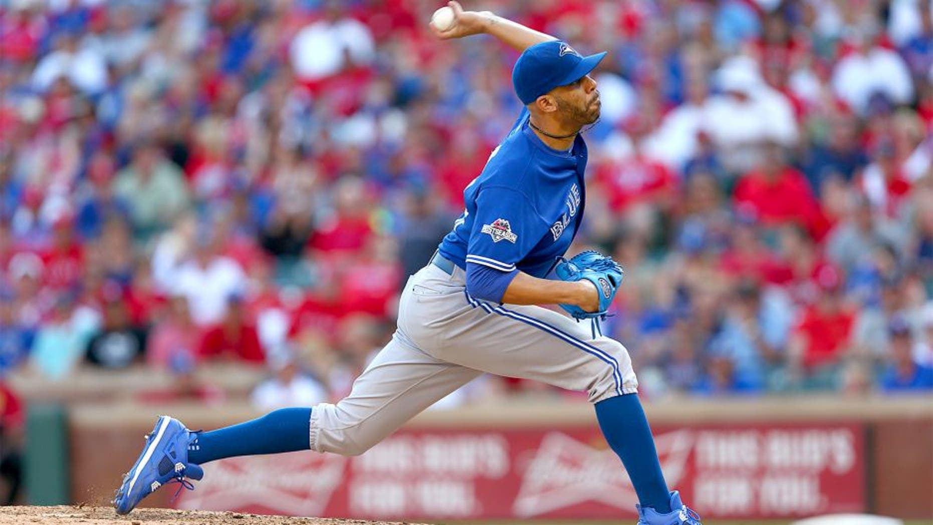 ARLINGTON, TEXAS - OCTOBER 12: David Price #14 of the Toronto Blue Jays pitches during Game 4 of the ALDS against the Texas Rangers at Globe Life Park on Monday, October 12, 2015 in Arlington, Texas. (Photo by Sarah Crabill/MLB Photos via Getty Images)
