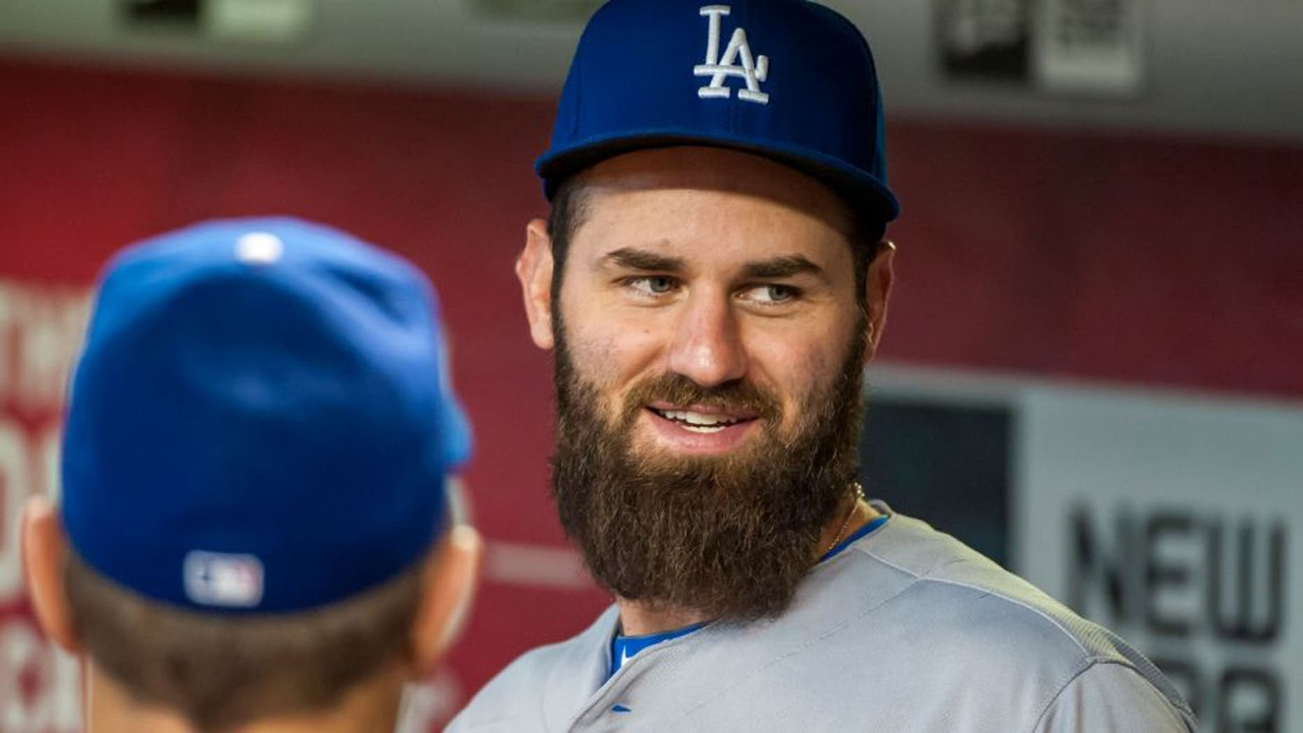 PHOENIX, AZ - SEPTEMBER 13: Scott Van Slyke #33 of the Los Angeles Dodgers talks with coach Tim Wallach #29 before a MLB game against the Arizona Diamondbacks on September 13, 2015 at Chase Field in Phoenix, Arizona. (Photo by Darin Wallentine/Getty Images)