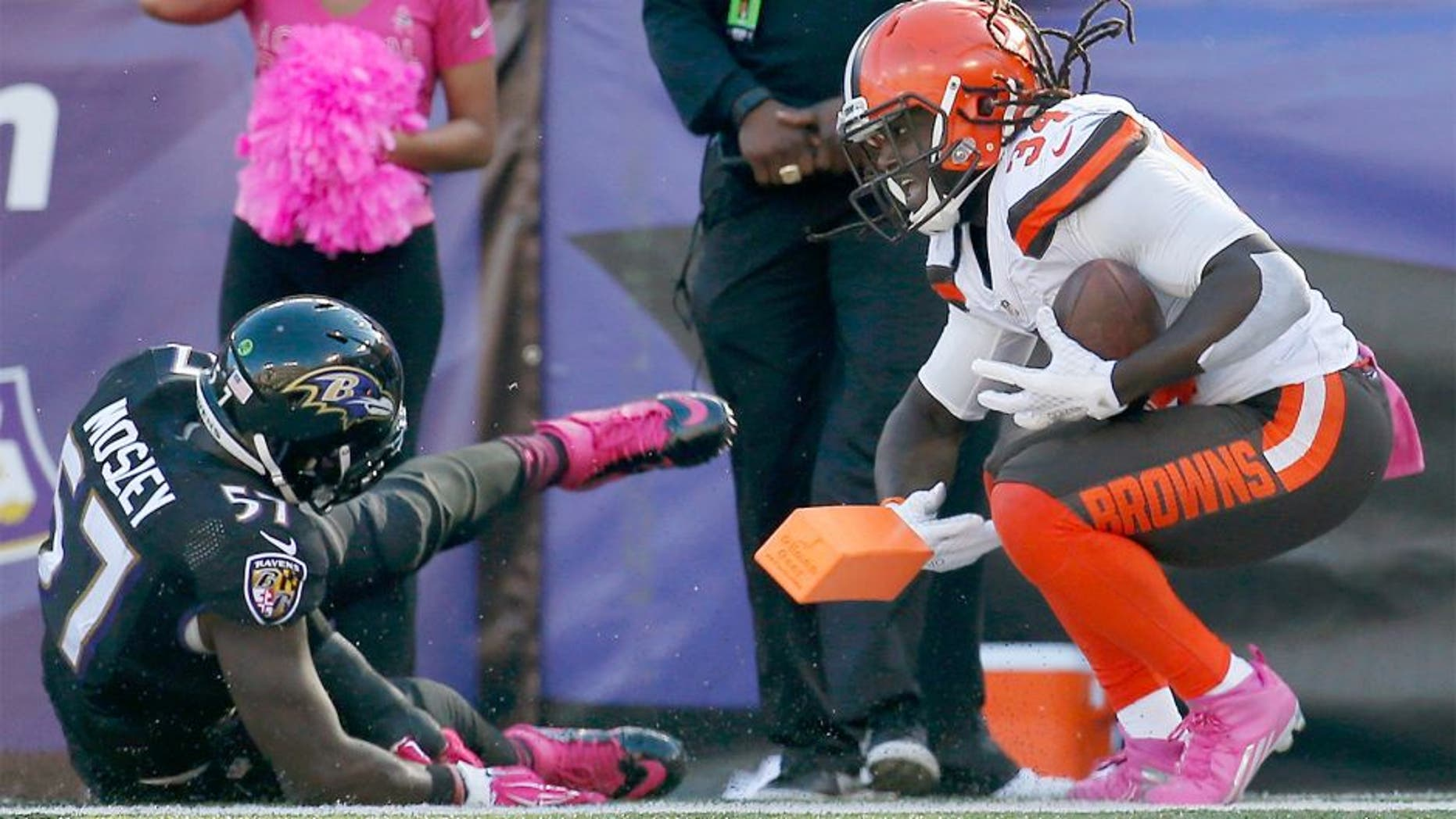 BALTIMORE, MD - OCTOBER 11: Running back Isaiah Crowell #34 of the Cleveland Browns reacts after scoring a second half touchdown in front of inside linebacker C.J. Mosley #57 of the Baltimore Ravens at M&T Bank Stadium on October 11, 2015 in Baltimore, Maryland. (Photo by Rob Carr/Getty Images)