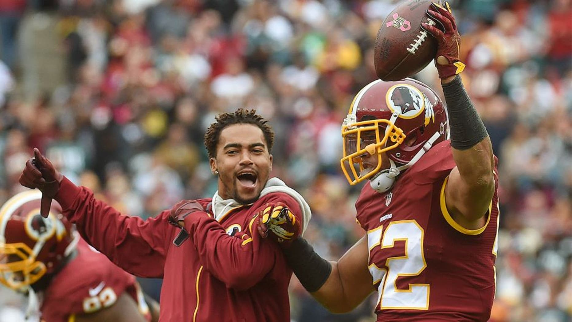 LANDOVER, MD- OCTOBER 4: CAPTION CORRECTION Washington Redskins wide receiver DeSean Jackson (11), left, joins Washington Redskins inside linebacker Keenan Robinson (52) as he celebrates his second-quarter fumble recovery in the game between the Washington Redskins and the Philadelphia Eagles at FedEx Field on Sunday, October 4, 2015. (Photo by Toni L. Sandys/ The Washington Post via Getty Images)