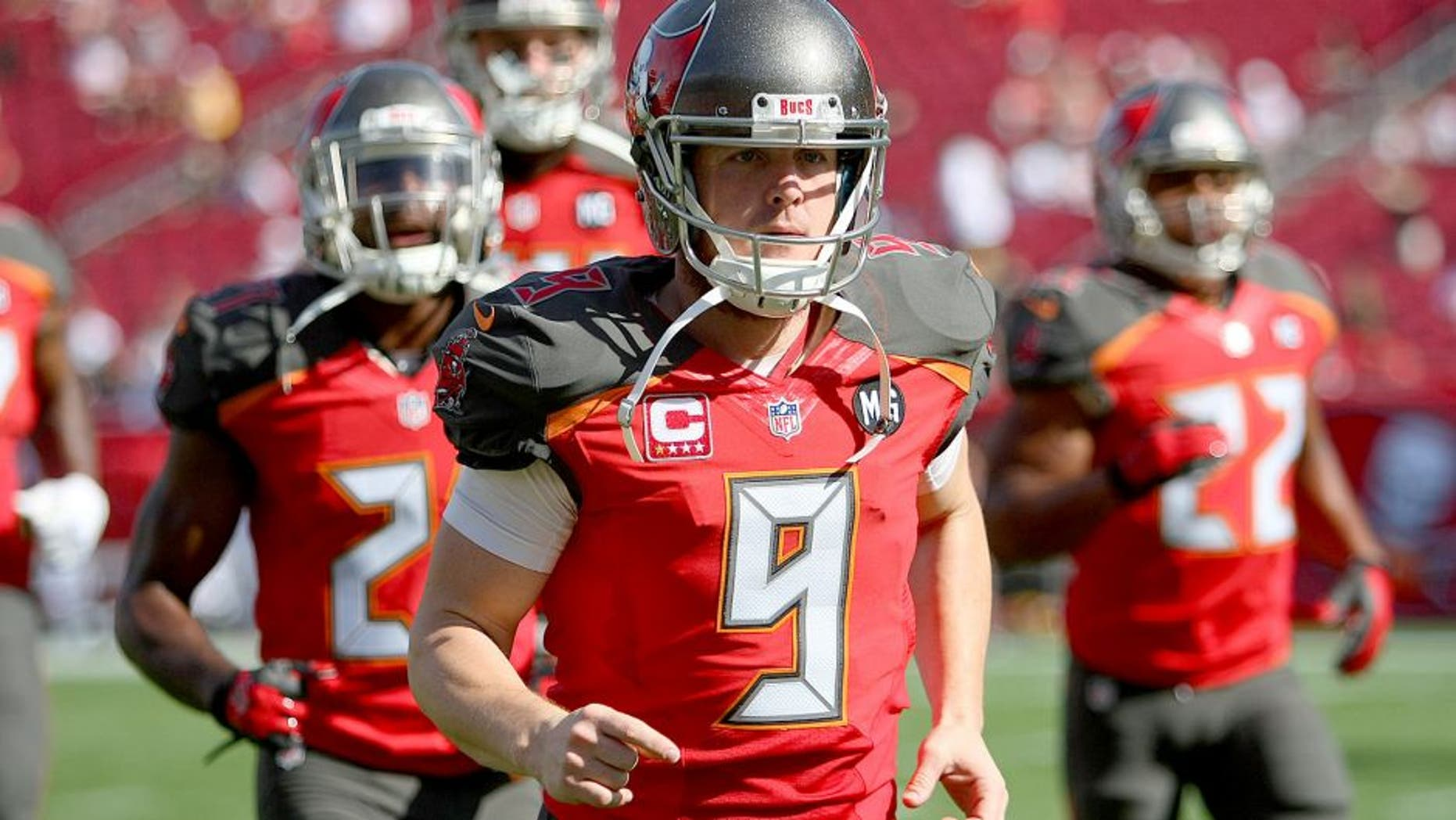 TAMPA, FL - DECEMBER 28: Michael Koenen #9 of the Tampa Bay Buccaneers is seen as he runs onto the field during an NFL football game against the New Orleans Saints at Raymond James Stadium on December 28, 2014 in Tampa, Florida. (Photo by Alex Menendez/Getty Images)