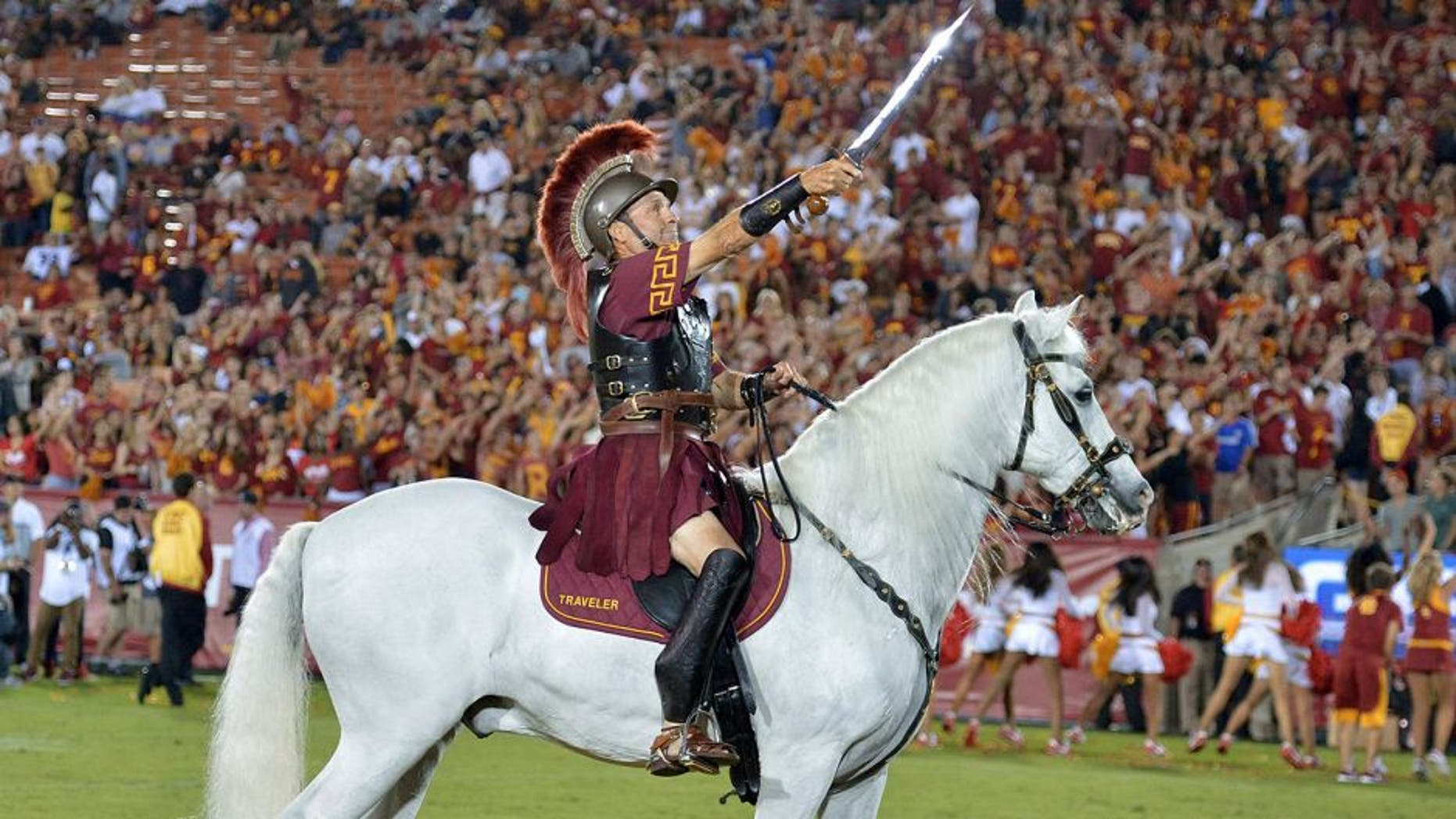 Sep 5, 2015; Los Angeles, CA, USA; Southern California Trojans white horse mascot Traveler with rider Hector Aguilar during the game against the Arkansas State Red Wolves at Los Angeles Memorial Coliseum. Mandatory Credit: Kirby Lee-USA TODAY Sports