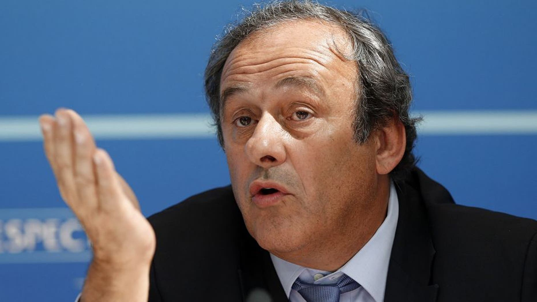 UEFA chief Michel Platini gestures as he speaks during a UEFA press conference after the draw for the UEFA Europa League football group stage 2015/16 on August 28, 2015 in Monaco. AFP PHOTO / VALERY HACHE (Photo credit should read VALERY HACHE/AFP/Getty Images)