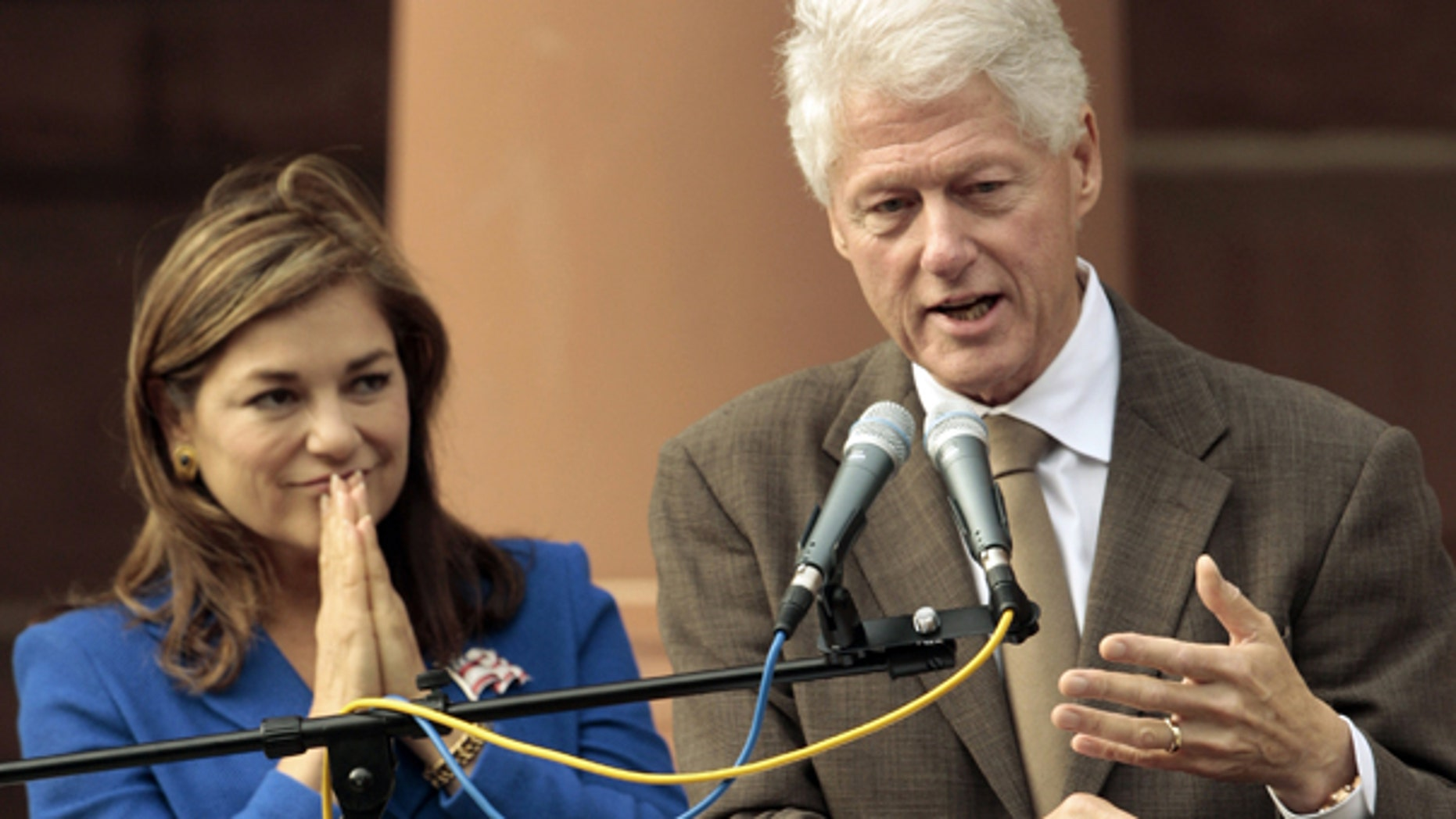 Oct. 15: Former U.S. President Bill Clinton campaigns for Rep. Loretta Sanchez, D-Calif. outside the Old Orange County Courthouse in Santa Ana, Calif.