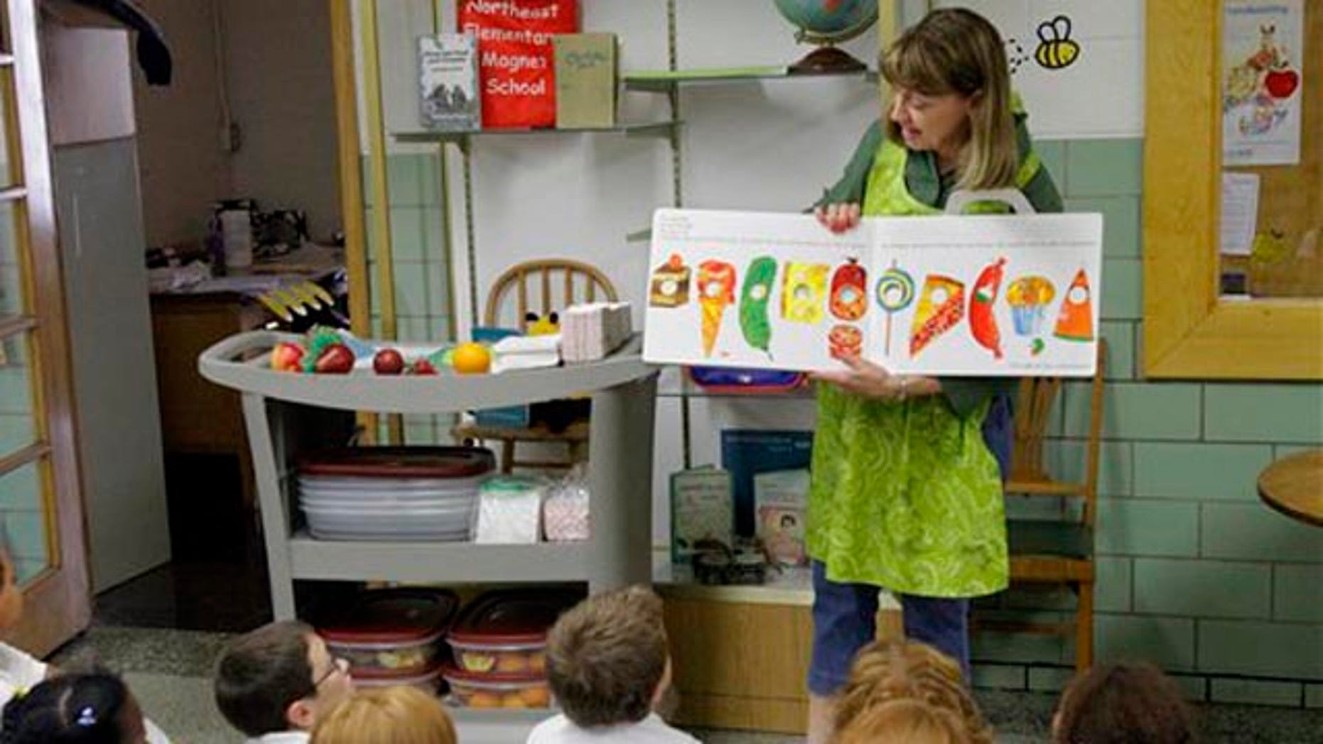 Sept. 20,: Nancy Henderson, home economic coordinator for the fresh fruit and vegetables program, works with the students at Northeast Elementary Magnet, in Danville, Ill.