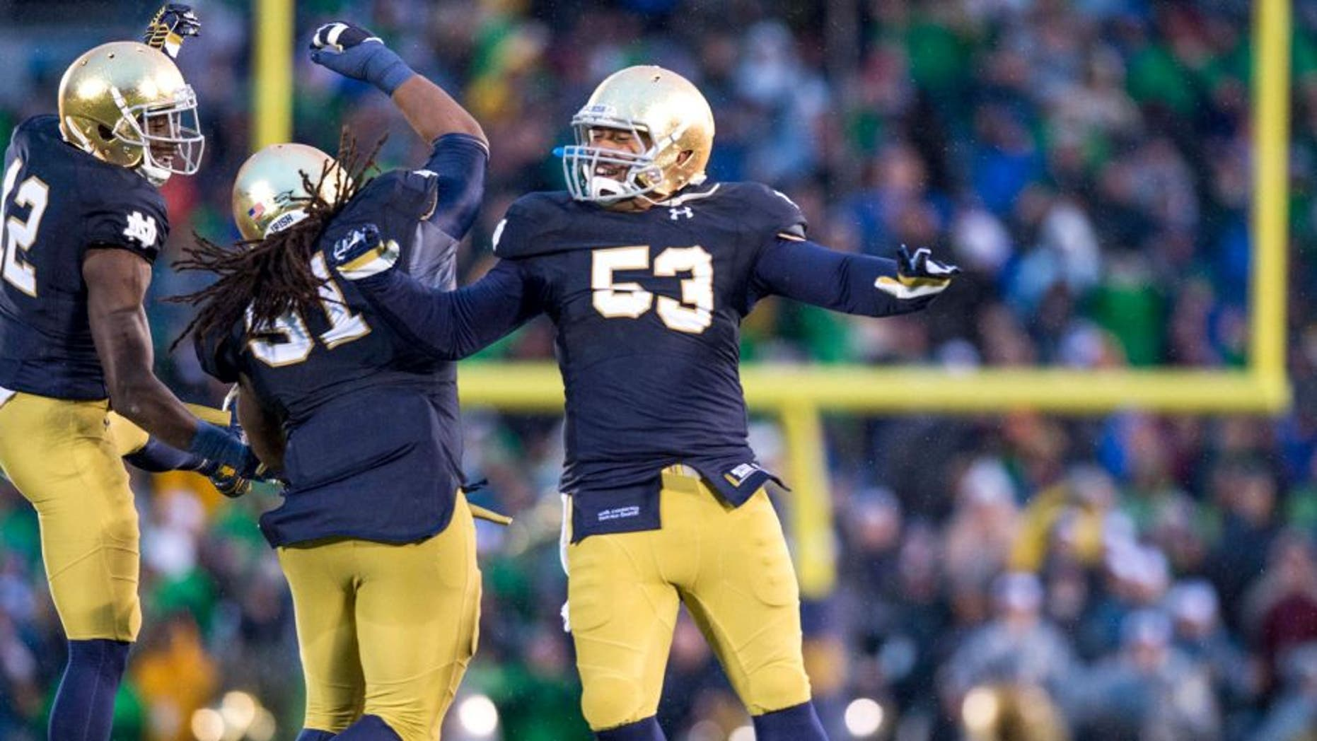 Notre Dame Fighting Irish cornerback Devin Butler (12) defensive lineman Sheldon Day (91) and defensive lineman Justin Utupo (53) react after Notre Dame defeated the Stanford Cardinal 17-14 at Notre Dame Stadium. Mandatory Credit: Matt Cashore-USA TODAY Sports