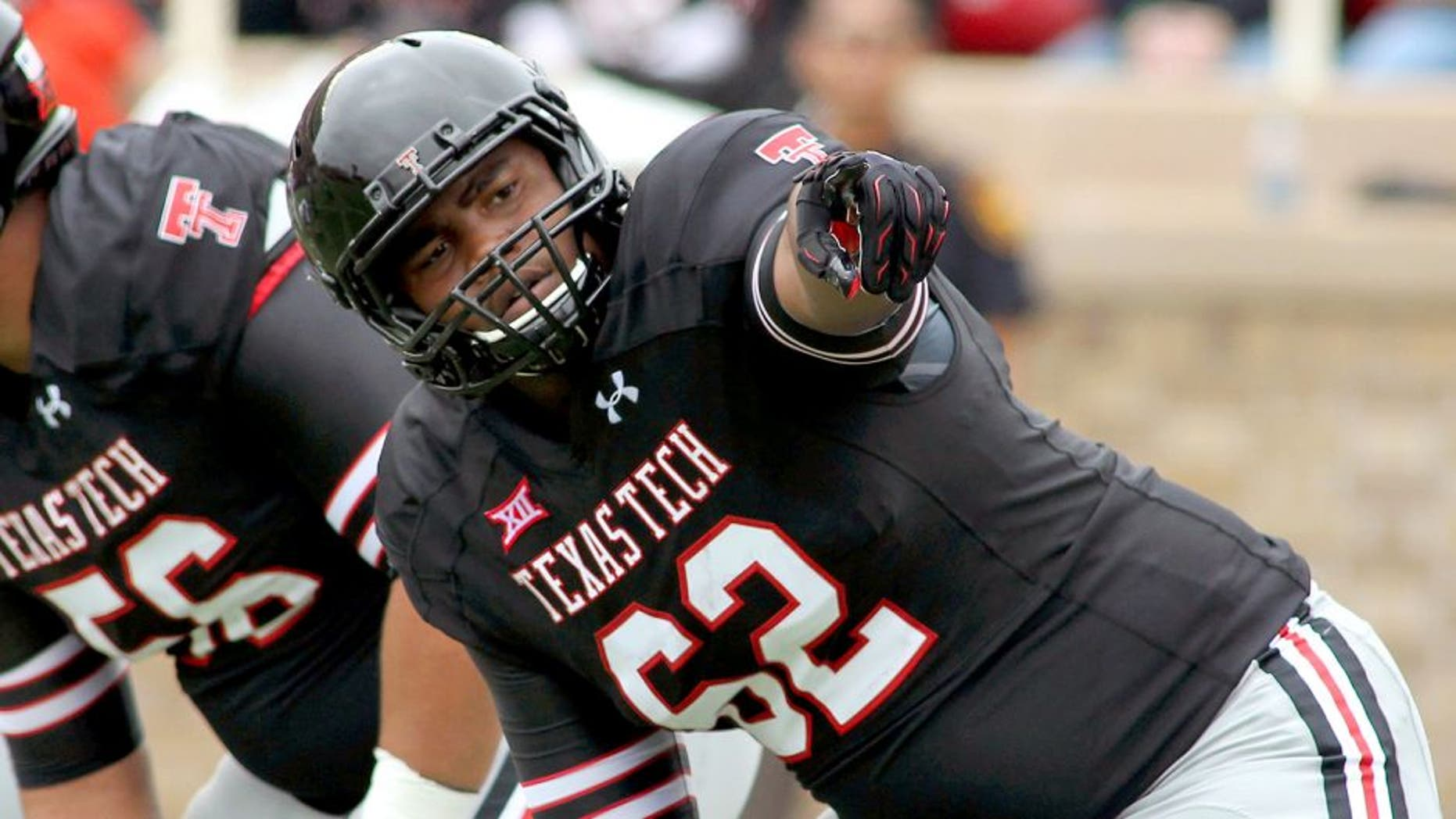 Sep 13, 2014; Lubbock, TX, USA; Texas Tech Red Raiders offensive tackle Le'Raven Clark (62) during the game with the Arkansas Razorbacks at Jones AT&T Stadium. Mandatory Credit: Michael C. Johnson-USA TODAY Sports