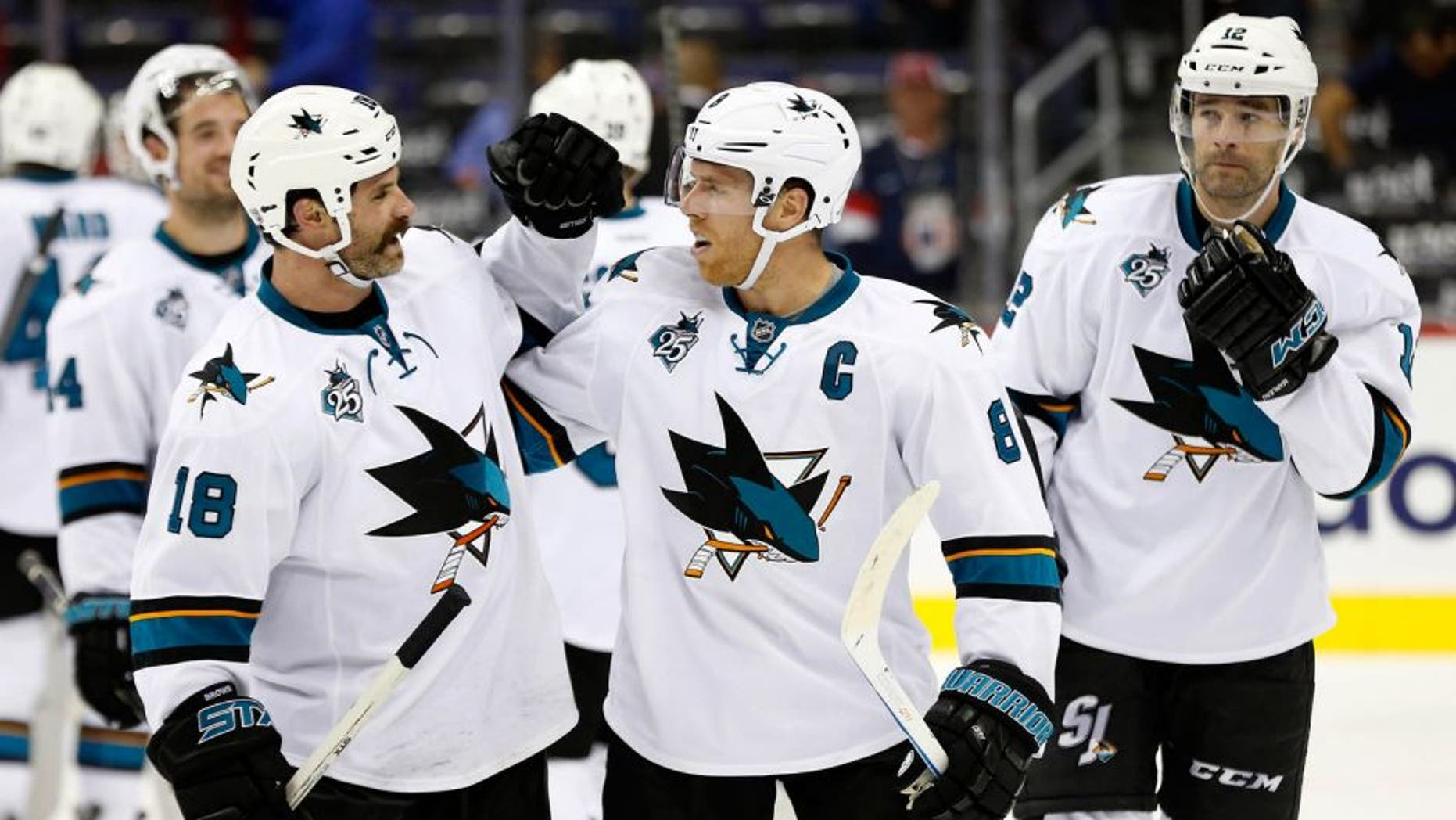 Oct 13, 2015; Washington, DC, USA; San Jose Sharks right wing Mike Brown (18) celebrates with Sharks center Joe Pavelski (8) after their game against the Washington Capitals at Verizon Center. The Sharks won 5-0. Mandatory Credit: Geoff Burke-USA TODAY Sports
