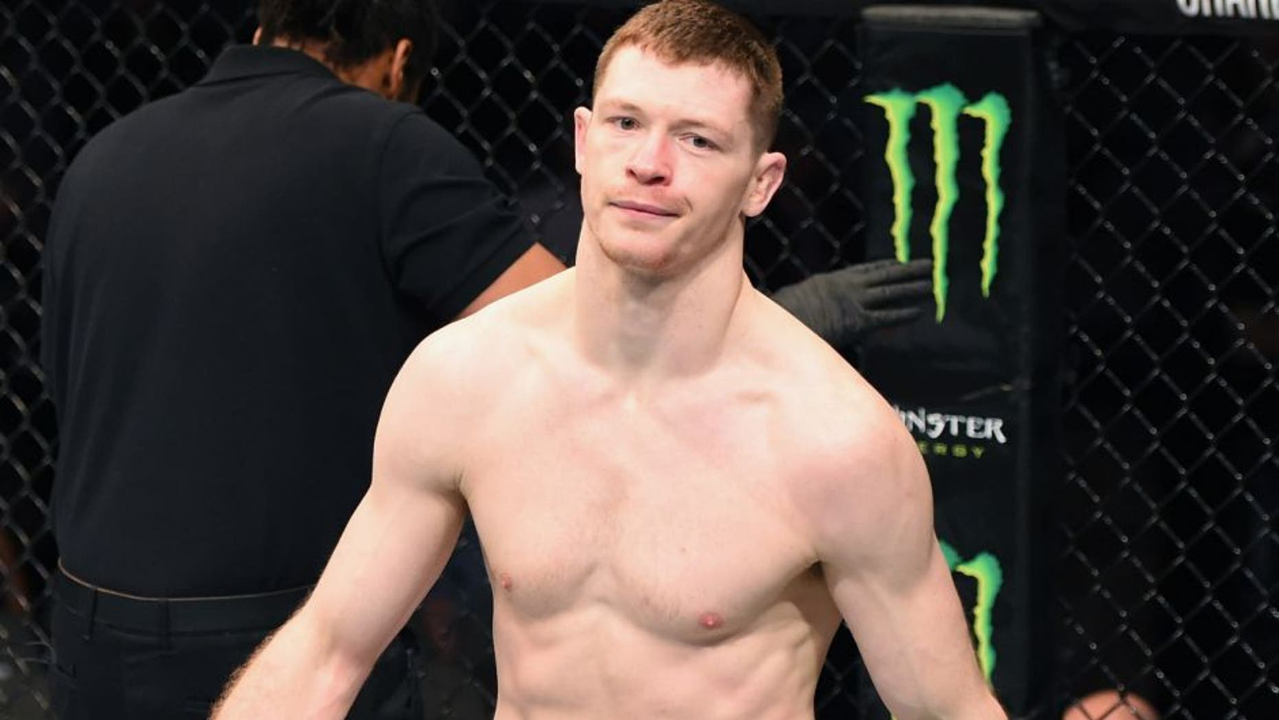 DALLAS, TX - MARCH 14: (L-R) Joseph Duffy walks back to this corner after defeating Jake Lindsey in their lightweight bout during the UFC 185 event at the American Airlines Center on March 14, 2015 in Dallas, Texas. (Photo by Josh Hedges/Zuffa LLC/Zuffa LLC via Getty Images)