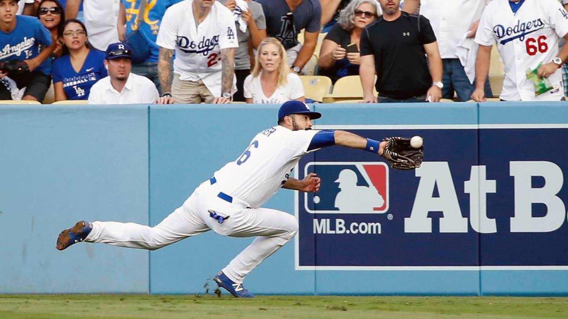 LOS ANGELES, CA - OCTOBER 15: Andre Ethier #16 of the Los Angeles Dodgers makes a diving catch on a ball hit by Michael Conforto #30 of the New York Mets in the second inning in game five of the National League Division Series at Dodger Stadium on October 15, 2015 in Los Angeles, California. (Photo by Sean M. Haffey/Getty Images)