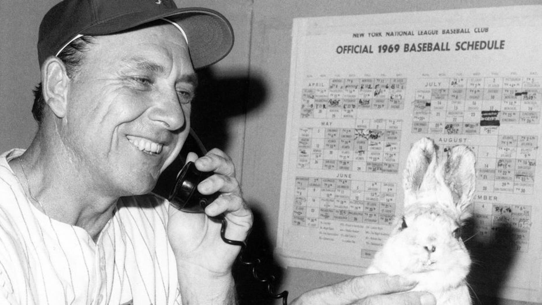 FLUSHING, NY - SEPTEMBER 8: Manager Gil Hodges of the New York Mets rubs a stuffed rabbit following the game against the Chicago Cubs on September 8, 1969 at Shea Stadium in Flushing, New York. (Photo by B Bennett/Getty Images)