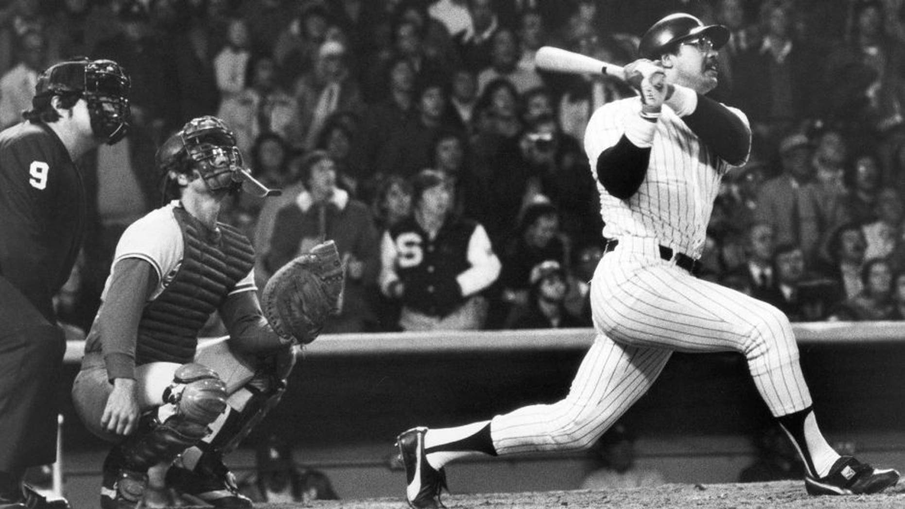 BRONX, NY - OCTOBER 18: Reggie Jackson of the New York Yankees hits his third consecutive home run of the game against the Los Angeles Dodgers in the eight inning of Game six of the 1977 World Series at Yankee Stadium on October 18, 1977 in the Bronx, New York. The Yankees defeated the Dodgers 8-4 and won the World Series four games to two. (Photo by Louis Requena/MLB Photos via Getty Images)