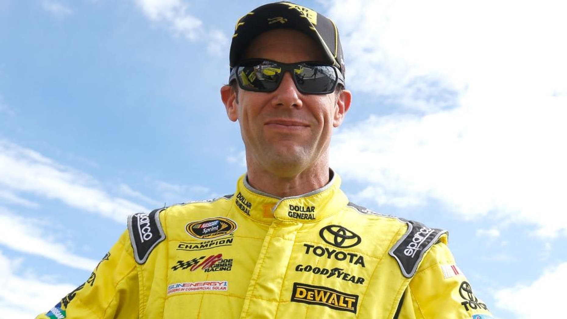 """Matt Kenseth, driver of the #20 Dollar General Toyota, stands on the grid during qualifying for the NASCAR Sprint Cup Series Axalta """"We Paint Winners"""" 400 at Pocono Raceway on June 5, 2015 in Long Pond, Pennsylvania."""