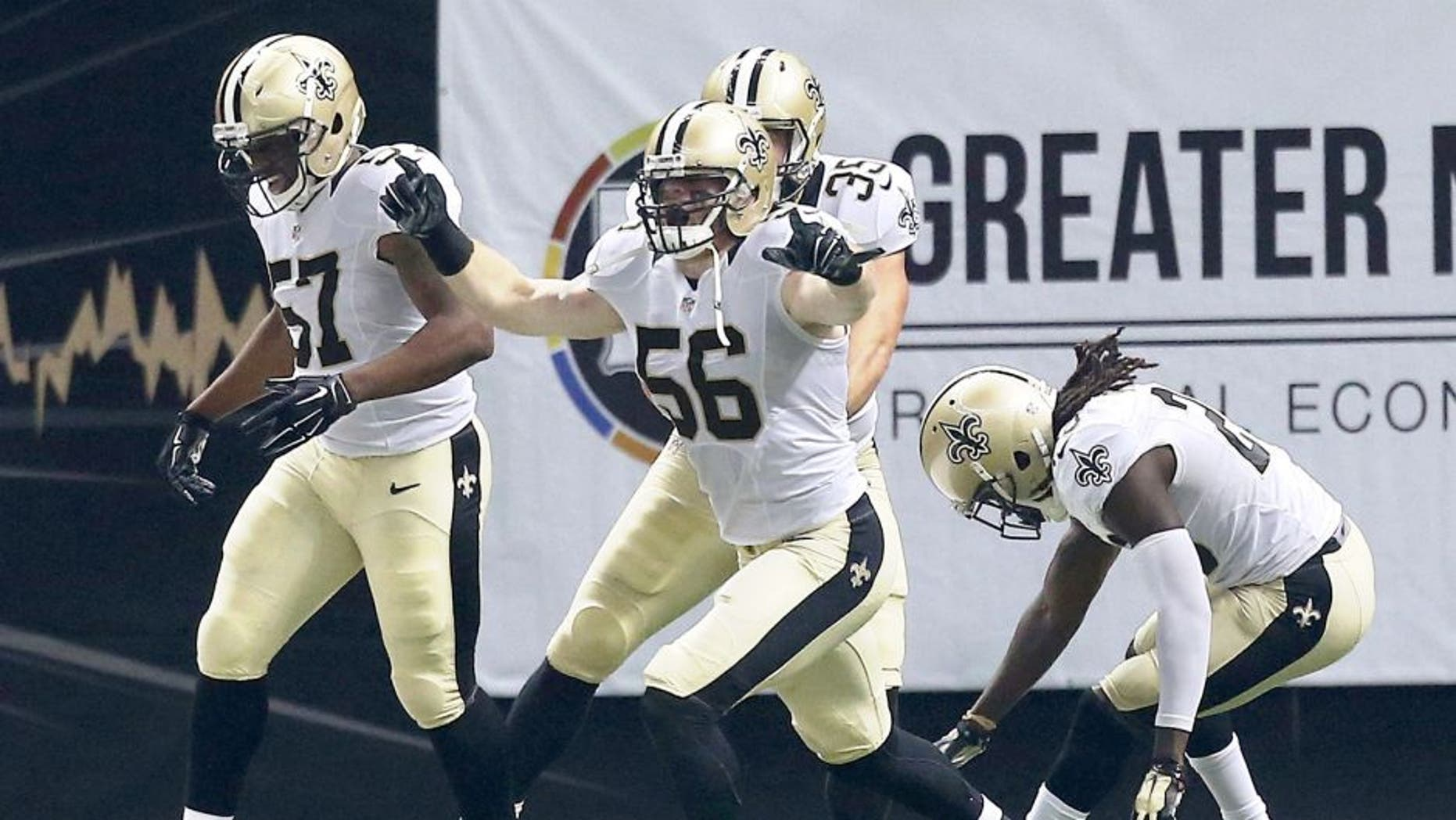 NEW ORLEANS, LA - OCTOBER 15: Michael Mauti #56 of the New Orleans Saints reacts to a touchdown folllowing a blocked punt during the first quarter of a game against the Atlanta Falcons at the Mercedes-Benz Superdome on October 15, 2015 in New Orleans, Louisiana. (Photo by Sean Gardner/Getty Images)