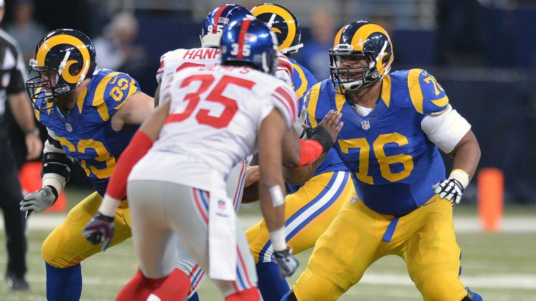 ST. LOUIS, MO - DECEMBER 21: Rodger Saffold #76 of the St. Louis Rams protects against the New York Giants at the Edward Jones Dome on December 21, 2014 in St. Louis, Missouri. (Photo by Michael Thomas/Getty Images)