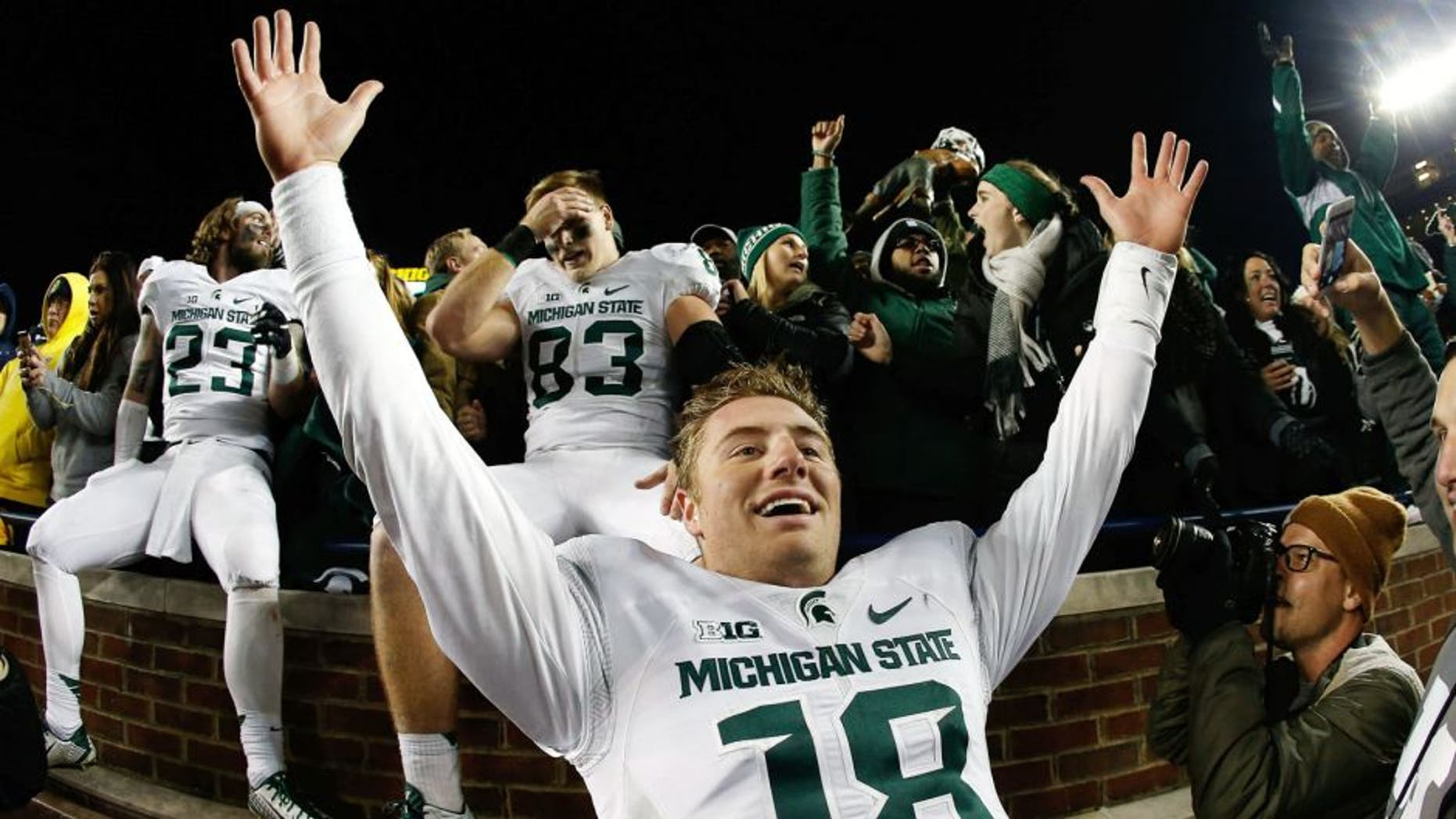 ANN ARBOR, MI - OCTOBER 17: Quarterback Connor Cook #18 of the Michigan State Spartans celebrates after defeating the Michigan Wolverines 27-23 in the college football game at Michigan Stadium on October 17, 2015 in Ann Arbor, Michigan. (Photo by Christian Petersen/Getty Images)