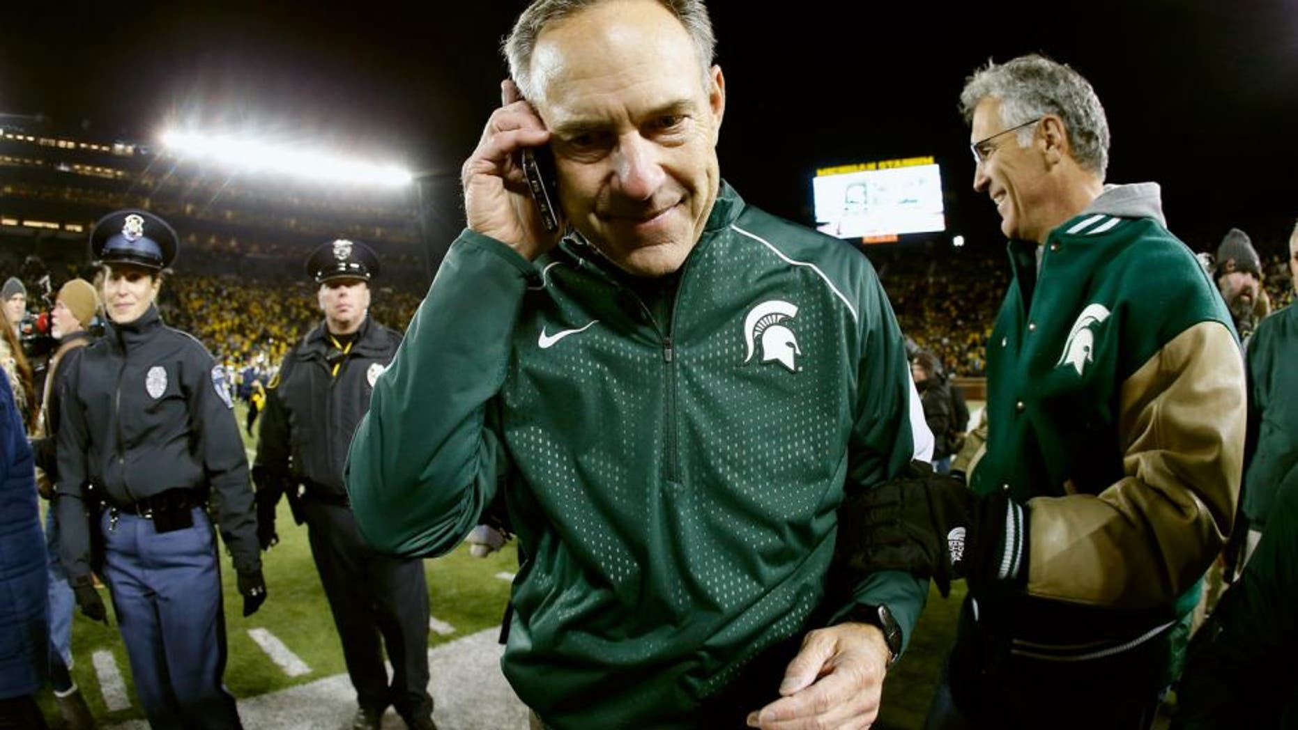ANN ARBOR, MI - OCTOBER 17: Head coach Mark Dantonio of the Michigan State Spartans walks off the field after defeating the Michigan Wolverines 27-23 in the college football game at Michigan Stadium on October 17, 2015 in Ann Arbor, Michigan. (Photo by Christian Petersen/Getty Images)