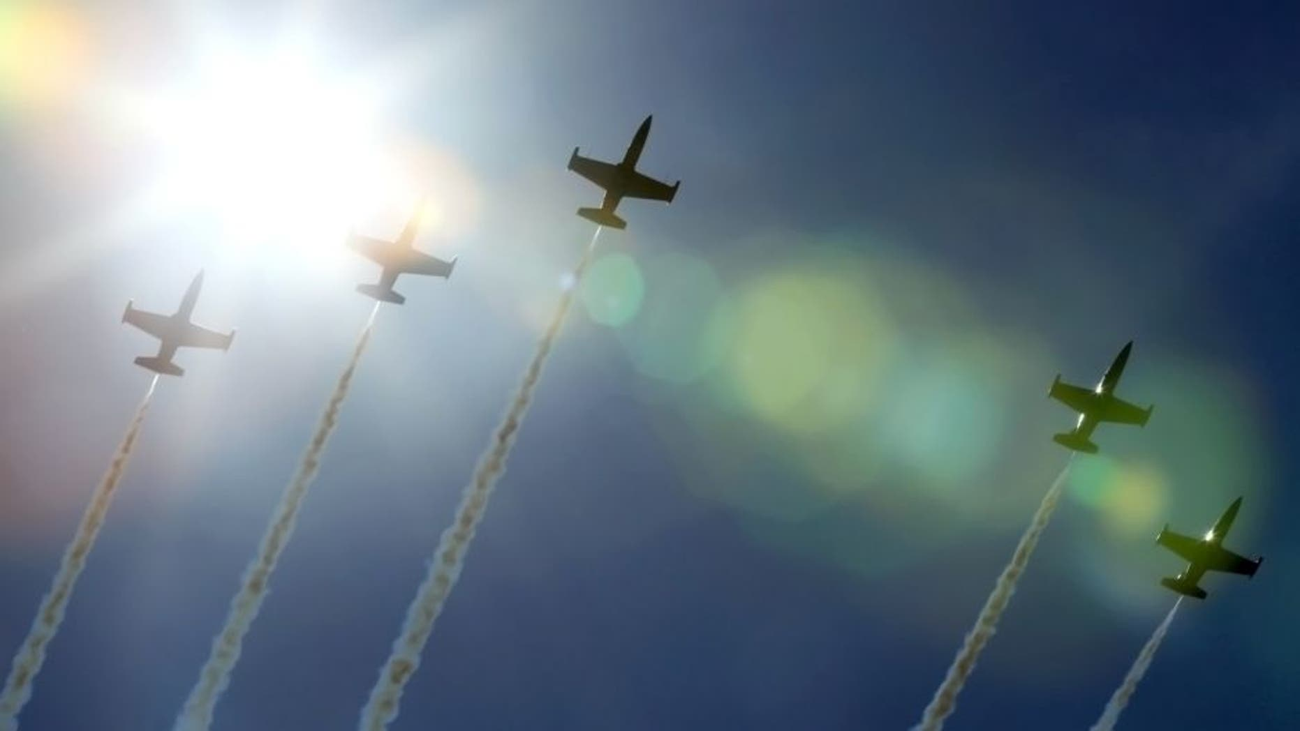 Jets from the Breitling Jet Team, made up of seven L-39C Albatros aircraft, fly over Gary, Ind., on Thursday, Aug. 13, 2015, amid practice for the Chicago Air and Water Show. (Antonio Perez/Chicago Tribune/TNS via Getty Images)