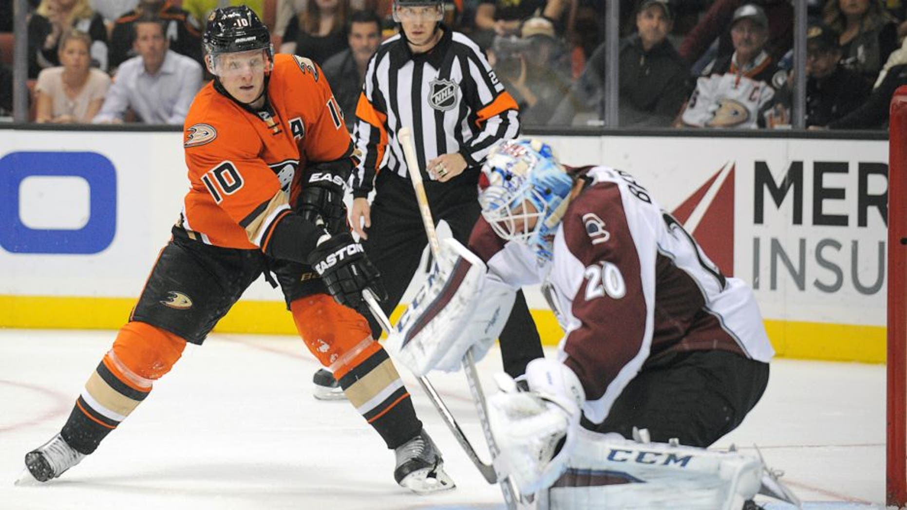 October 16, 2015; Anaheim, CA, USA; Anaheim Ducks right wing Corey Perry (10) shoots against Colorado Avalanche goalie Reto Berra (20) during the second period at Honda Center. Mandatory Credit: Gary A. Vasquez-USA TODAY Sports