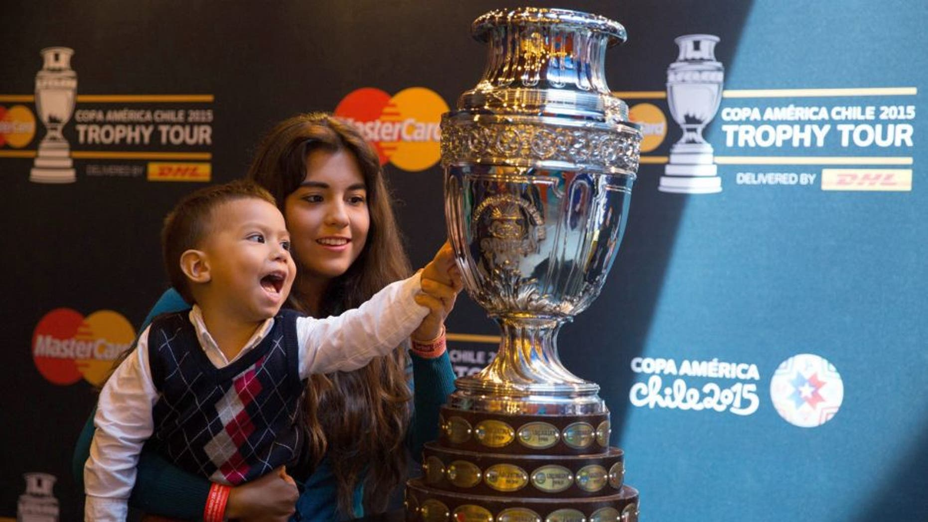 MEXICO CITY, MEXICO - MAY 21: A child touches the Copa America's Trophy during the Copa America Trophy Tour at Papalote Museo del Niño in Mexico City, Mexico on May 21, 2015. Copa America Tournament will be held in Chile from 11 June to 4 July. (Photo by Daniel Cardenas/Anadolu Agency/Getty Images)