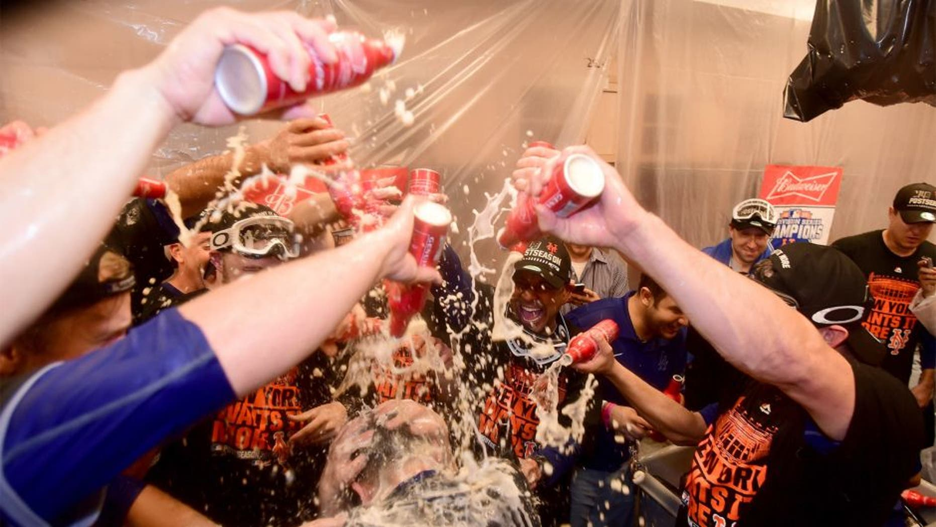LOS ANGELES, CA - OCTOBER 15: The New York Mets celebrate in the locker room after the Mets 3-2 victory against the Los Angeles Dodgers in game five of the National League Division Series at Dodger Stadium on October 15, 2015 in Los Angeles, California. (Photo by Harry How/Getty Images)