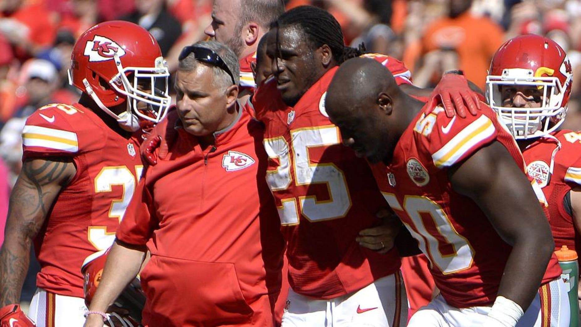 Oct 11, 2015; Kansas City, MO, USA; Kansas City Chiefs running back Jamaal Charles (25) is helped off the field against the Chicago Bears in the second half at Arrowhead Stadium. Chicago won the game 18-17. Mandatory Credit: John Rieger-USA TODAY Sports