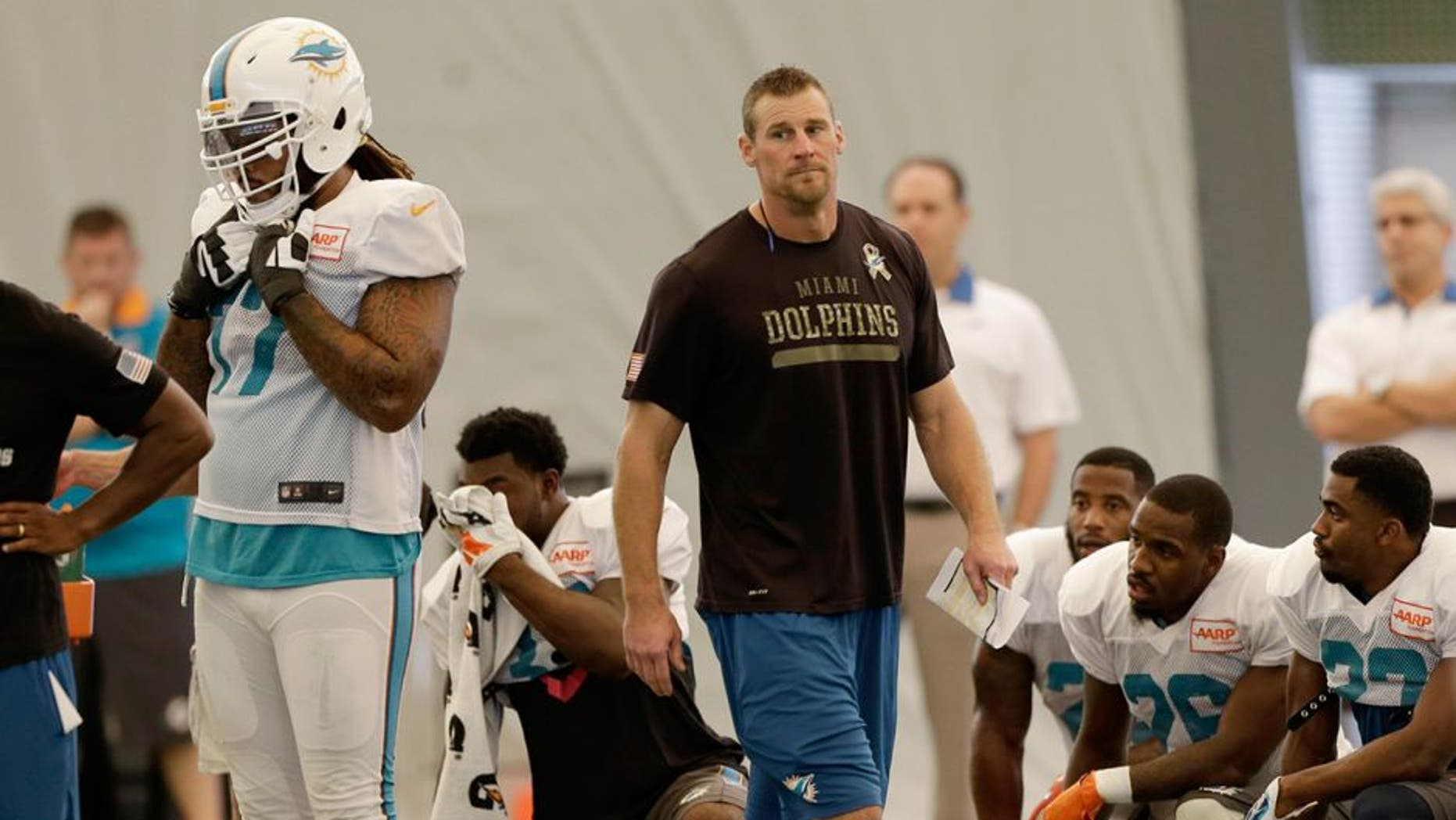 Miami Dolphins interim coach Dan Campbell walks on the field during NFL football practice in Davie, Fla., Wednesday, Oct. 7, 2015. (AP Photo/Alan Diaz)