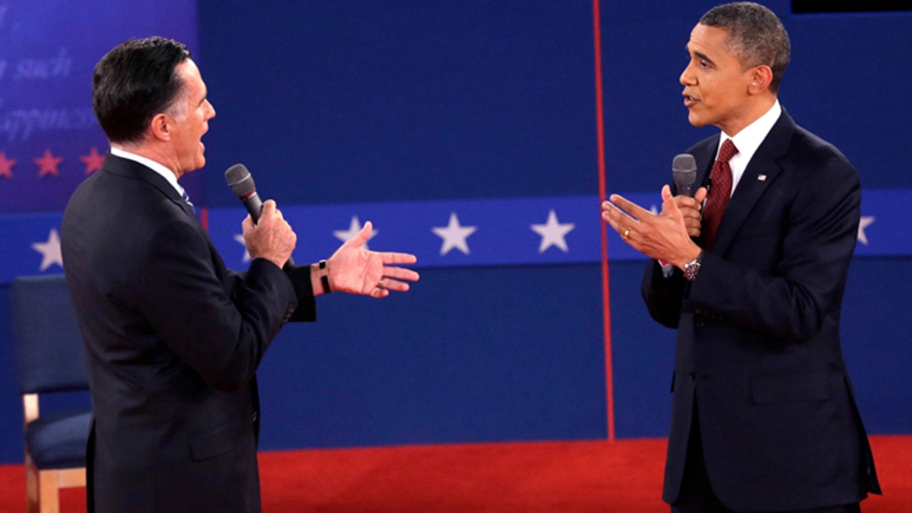 Oct. 16, 2012: Republican presidential nominee Mitt Romney and President Barack Obama speak during the second presidential debate.