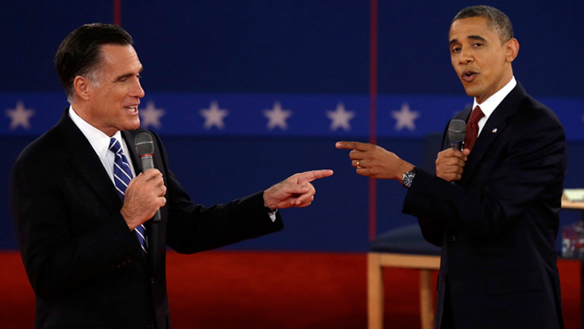 Oct. 16, 2012: Republican presidential nominee Mitt Romney  and President Barack Obama spar during the second presidential debate.