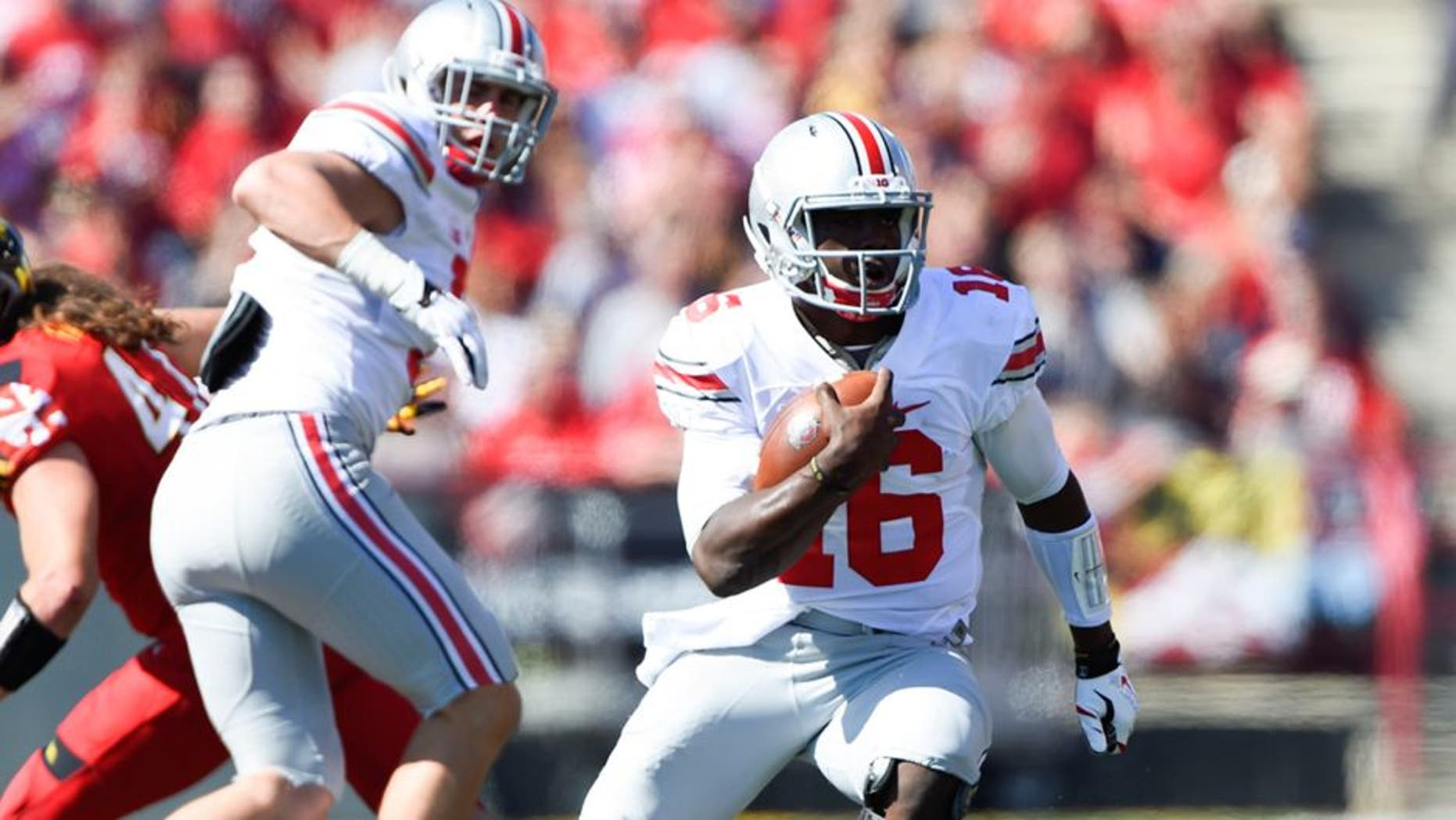 Oct 4, 2014; College Park, MD, USA; Ohio State Buckeyes quarterback J.T. Barrett (16) runs with the ball during the second quarter against the Maryland Terrapins at Byrd Stadium. Mandatory Credit: Tommy Gilligan-USA TODAY Sports