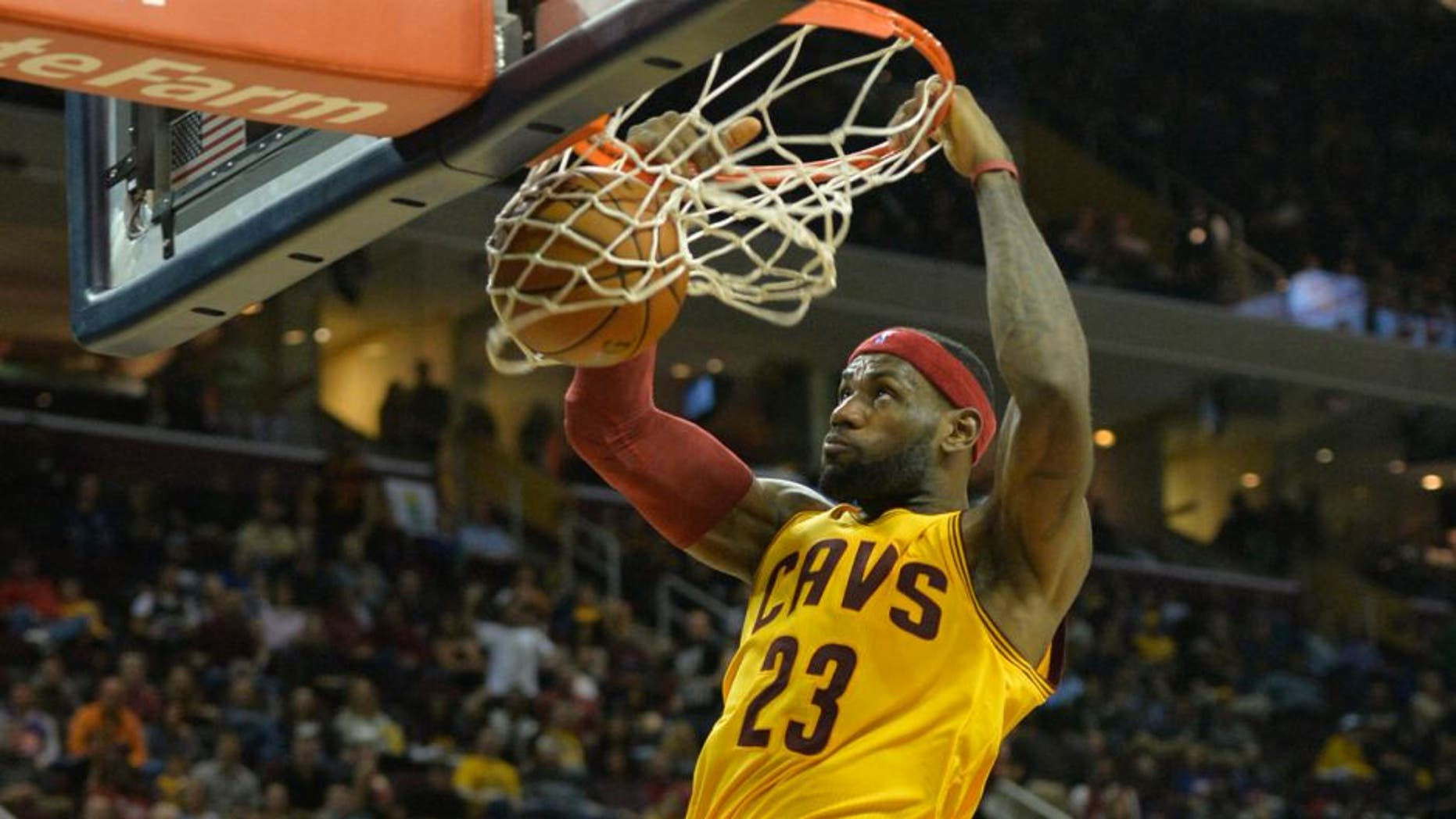 Oct 17, 2014; Cleveland, OH, USA; Cleveland Cavaliers forward LeBron James (23) dunks in the third quarter against the Dallas Mavericks at Quicken Loans Arena. After a video review by officials, the basket was taken away due to a foul before the score. Mandatory Credit: David Richard-USA TODAY Sports
