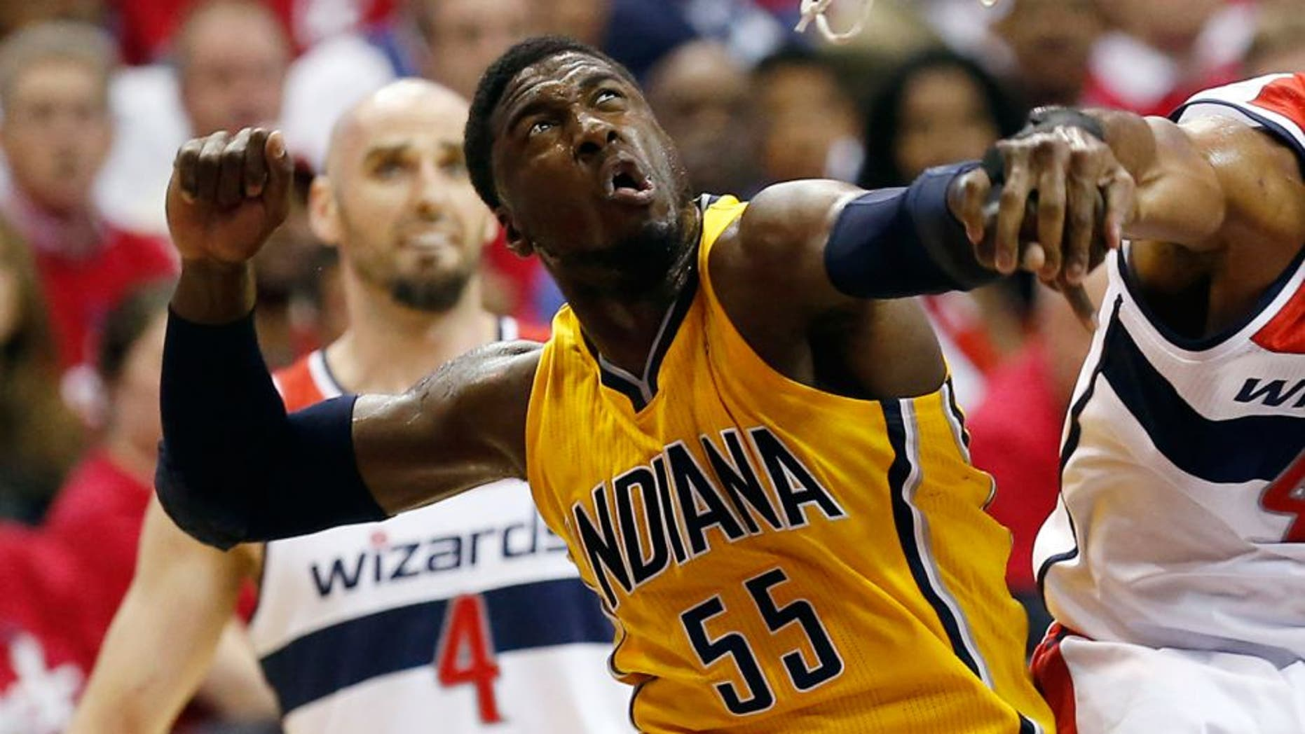 May 15, 2014; Washington, DC, USA; Indiana Pacers center Roy Hibbert (55) blocks the shot of Washington Wizards forward Nene (42) in the first quarter in game six of the second round of the 2014 NBA Playoffs at Verizon Center. Mandatory Credit: Geoff Burke-USA TODAY Sports