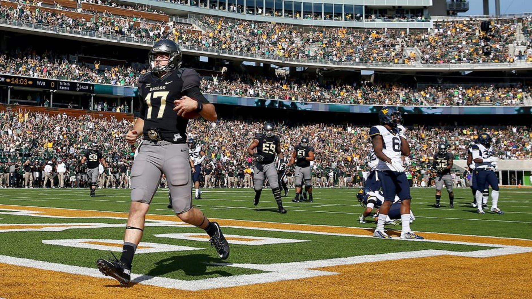 WACO, TX - OCTOBER 17: Seth Russell #17 of the Baylor Bears scores a touchdown against the West Virginia Mountaineers in the second quarter at McLane Stadium on October 17, 2015 in Waco, Texas. (Photo by Tom Pennington/Getty Images)