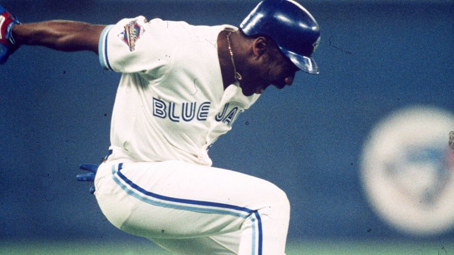 TORONTO, ON - OCTOBER 23: Joe Carter #29 of the Toronto Blue Jays celebrates after hitting a walk off home run in the ninth inning during Game Six of the 1993 World Series at the Toronto SkyDome on October 23, 1993 in Toronto, Ontario, Canada. (Photo by MLB Photos)