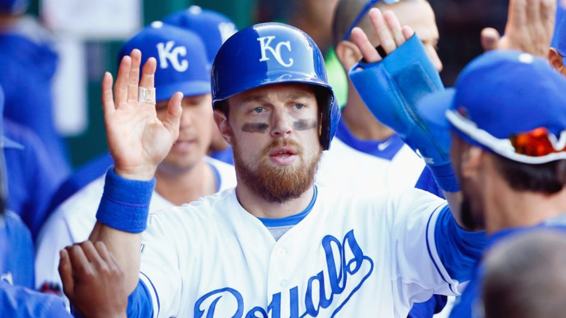 Ben Zobrist #18 of the Kansas City Royals celebrates in the dugout after scoring a run in the seventh inning against the Toronto Blue Jays in game two of the American League Championship Series at Kauffman Stadium on October 17, 2015 in Kansas City, Missouri. (Photo by Jamie Squire/Getty Images)