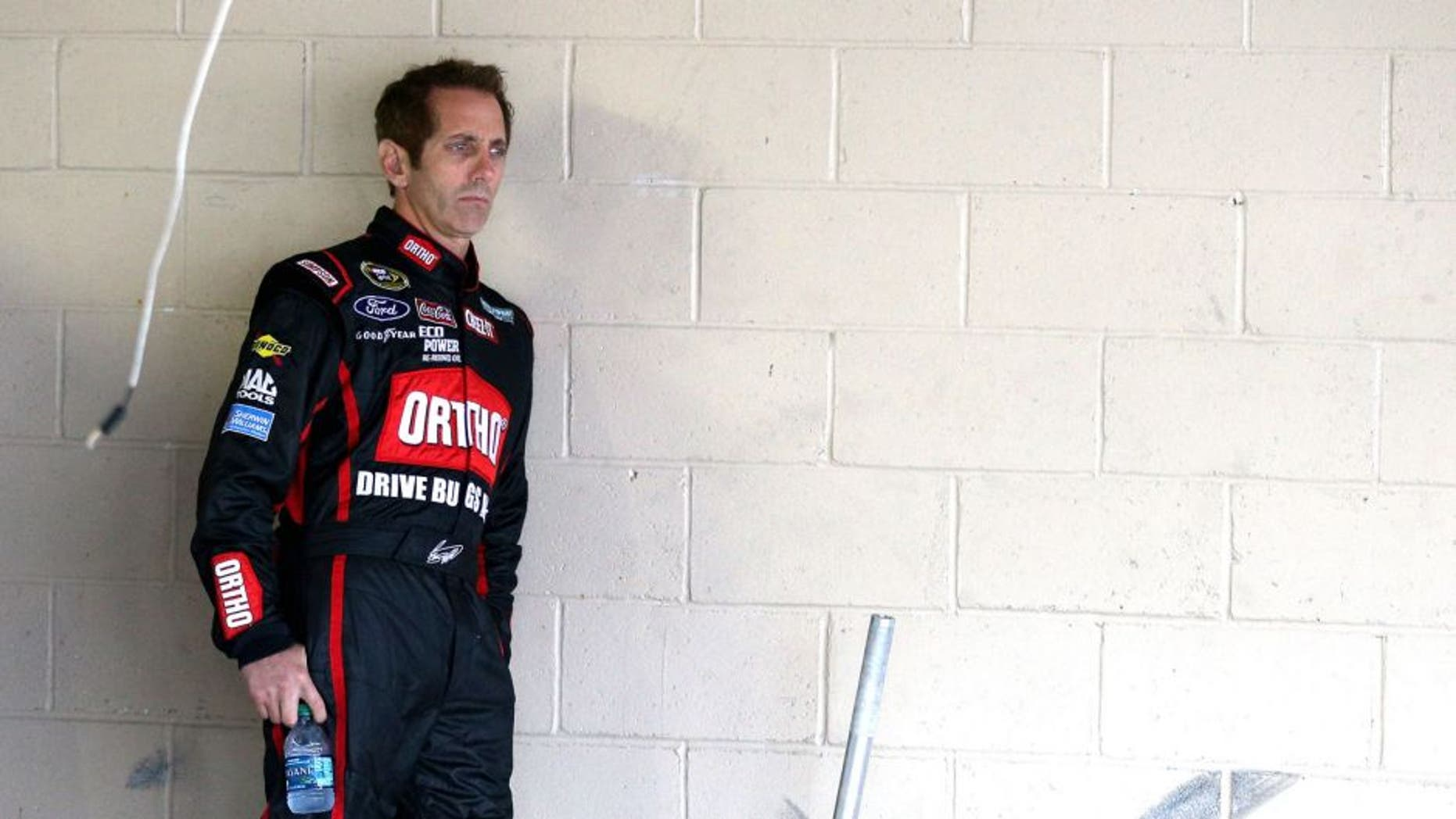 DOVER, DE - OCTOBER 03: Greg Biffle, driver of the #16 Ortho Ford, looks on in the garage area during practice for the NASCAR Sprint Cup Series AAA 400 at Dover International Speedway on October 3, 2015 in Dover, Delaware. (Photo by Patrick Smith/Getty Images)