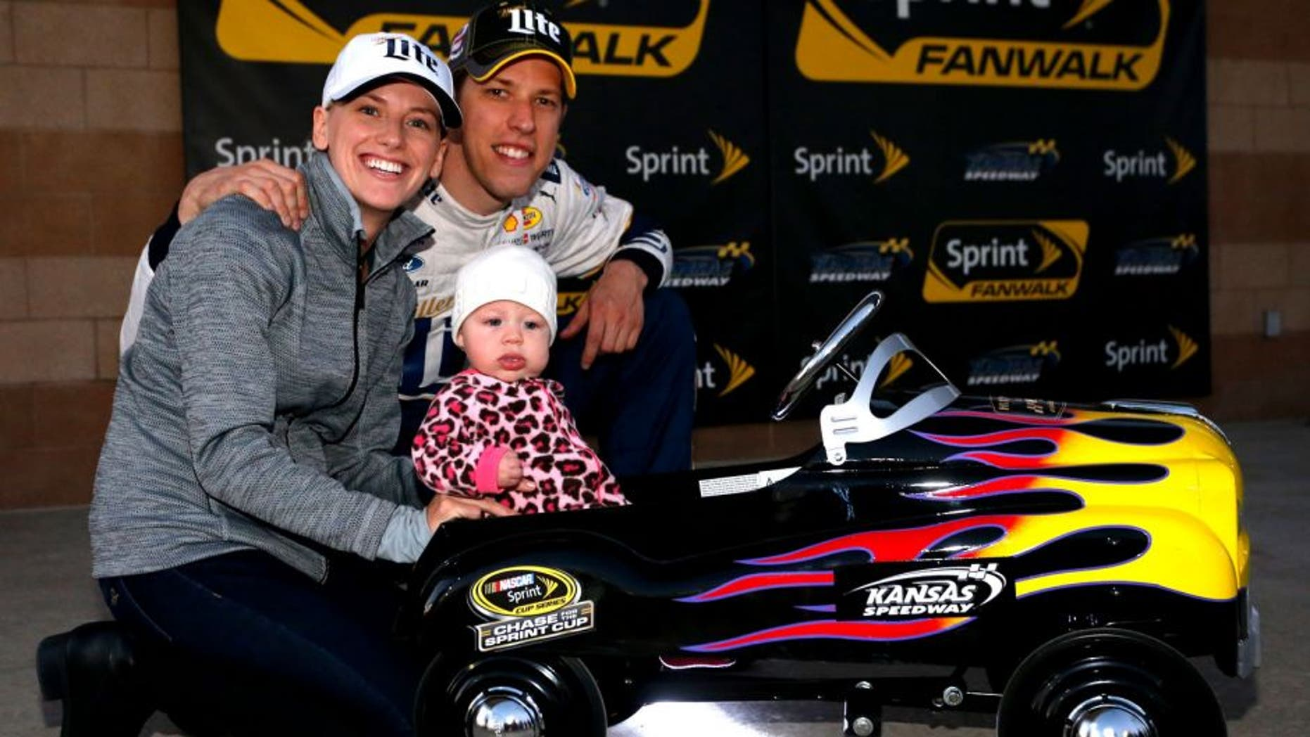 KANSAS CITY, KS - OCTOBER 16: Brad Keselowski, driver of the #2 Miller Lite Ford, poses with his girlfriend Paige White and their daughter Scarlett after Keselowski qualified on the pole for the NASCAR Sprint Cup Series Hollywood Casino 400 at Kansas Speedway on October 16, 2015 in Kansas City, Kansas. (Photo by Brian Lawdermilk/NASCAR via Getty Images)