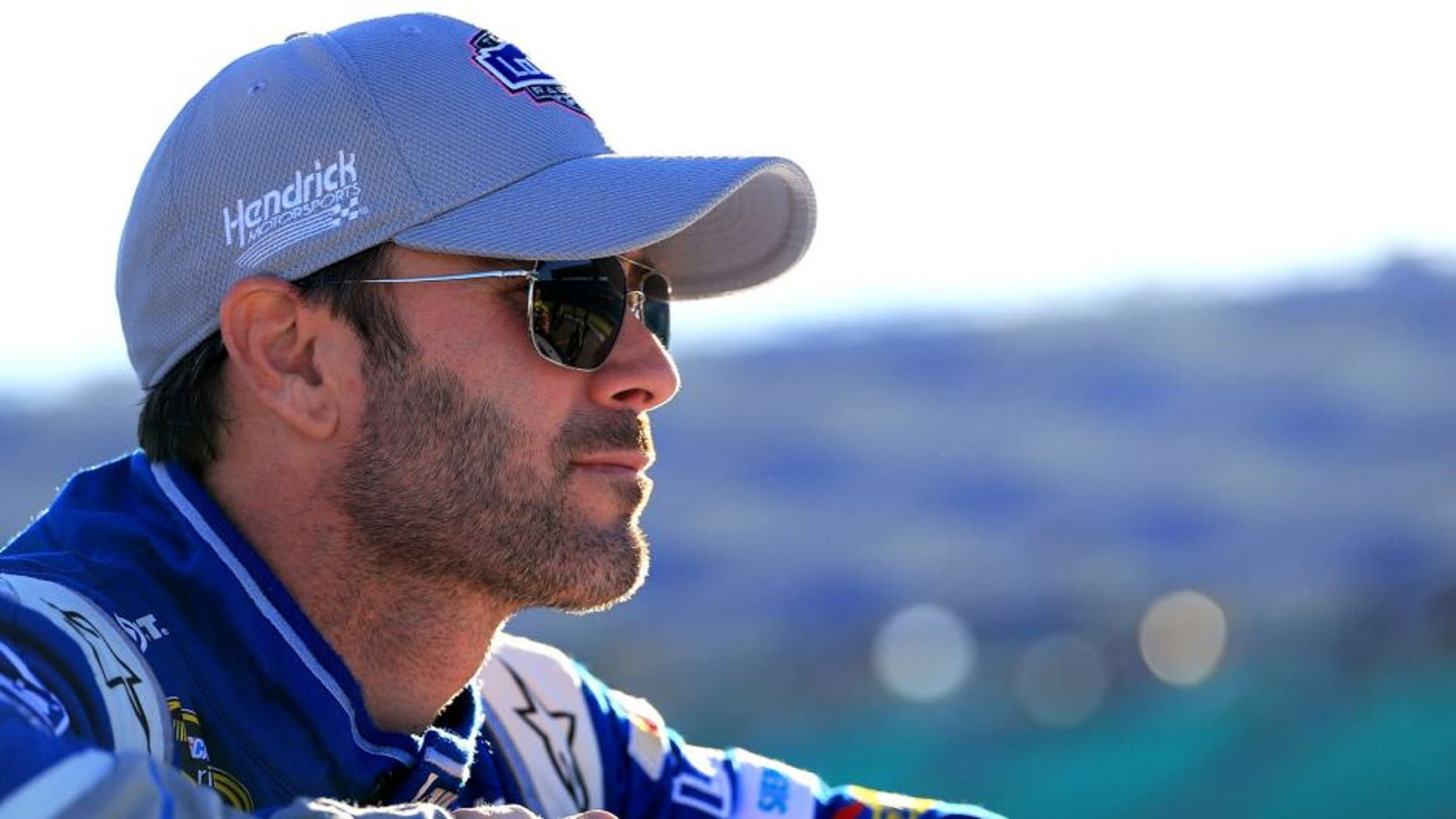KANSAS CITY, KS - OCTOBER 16: Jimmie Johnson, driver of the #48 Lowe's Chevrolet, looks on during qualifying for the NASCAR Sprint Cup Series Hollywood Casino 400 at Kansas Speedway on October 16, 2015 in Kansas City, Kansas. (Photo by Daniel Shirey/Getty Images)