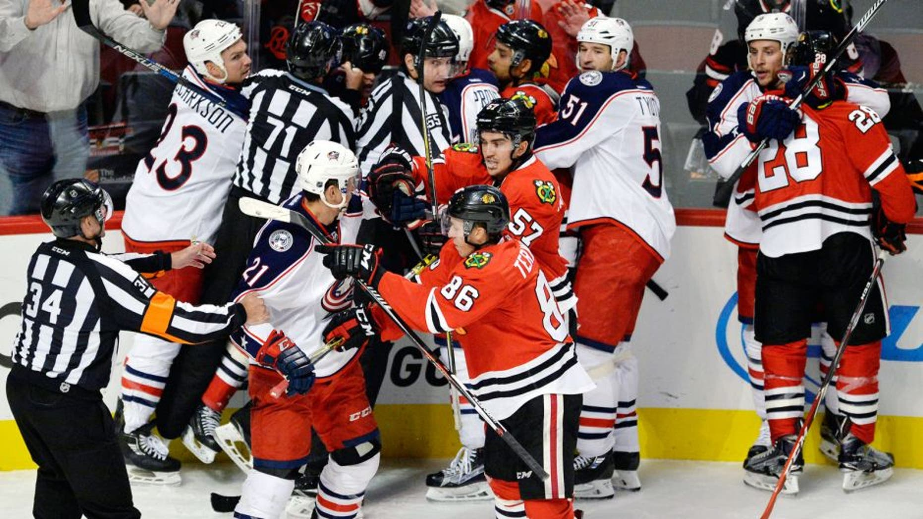 Chicago Blackhawks players scuffle with Columbus Blue Jackets players during the third period of an NHL hockey game Saturday, Oct. 17, 2015, in Chicago. Chicago won 4-1. (AP Photo/Paul Beaty)