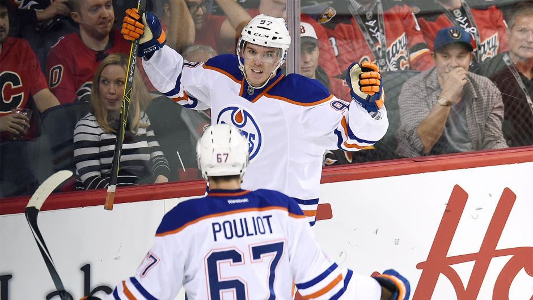 Oct 17, 2015; Calgary, Alberta, CAN; Edmonton Oilers center Connor McDavid (97) celebrates his second period goal against the Calgary Flames at Scotiabank Saddledome. Mandatory Credit: Candice Ward-USA TODAY Sports