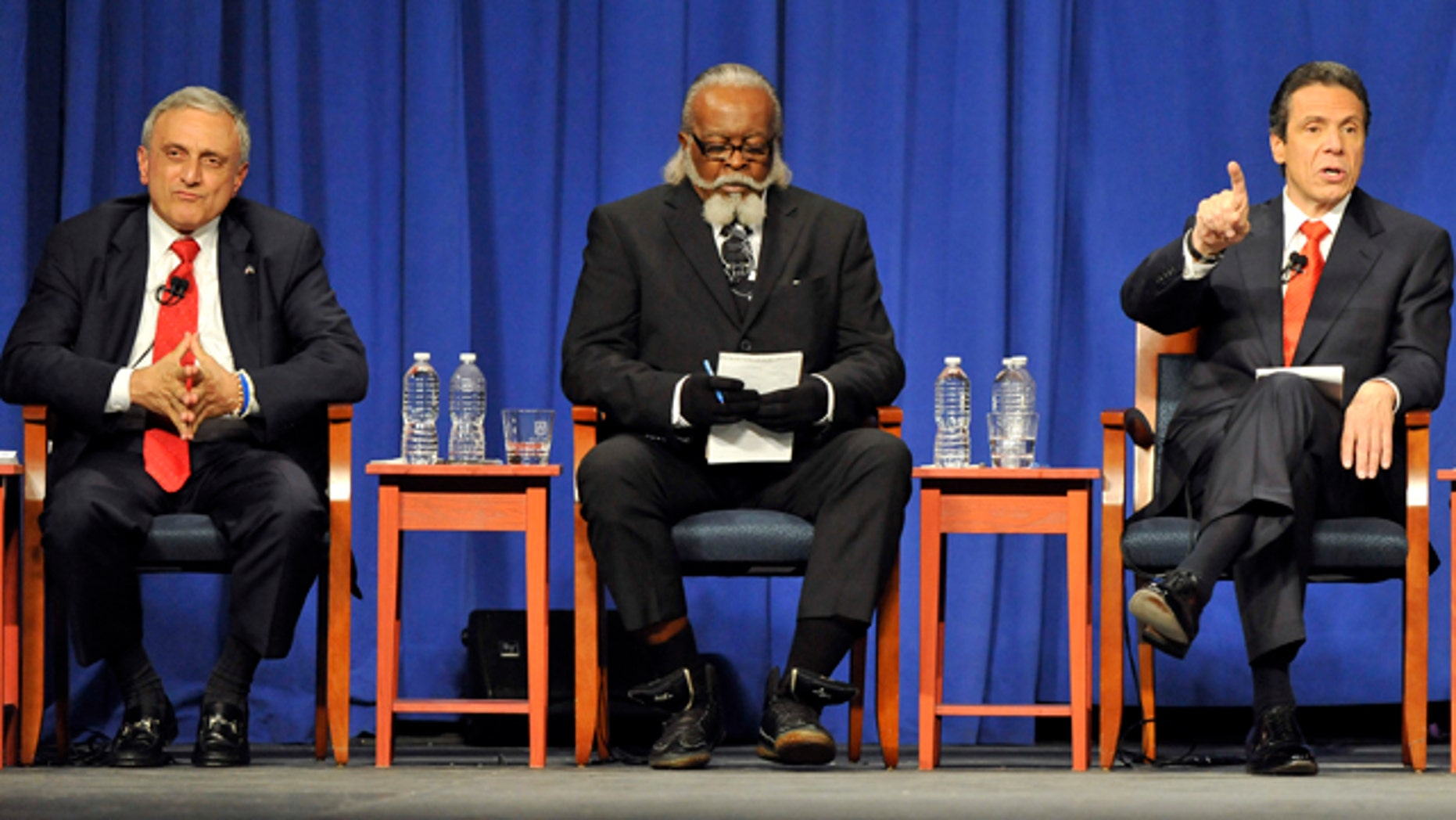 Oct. 18, 2010: Republican candidate Carl Paladino, left, listens with Rent is 2 Damn High candidate Jimmy McMillan as Democratic candidate Andrew Cuomo speaks during the 2010 New York State gubernatorial debate at Hofstra University in Hempstead, N.Y.