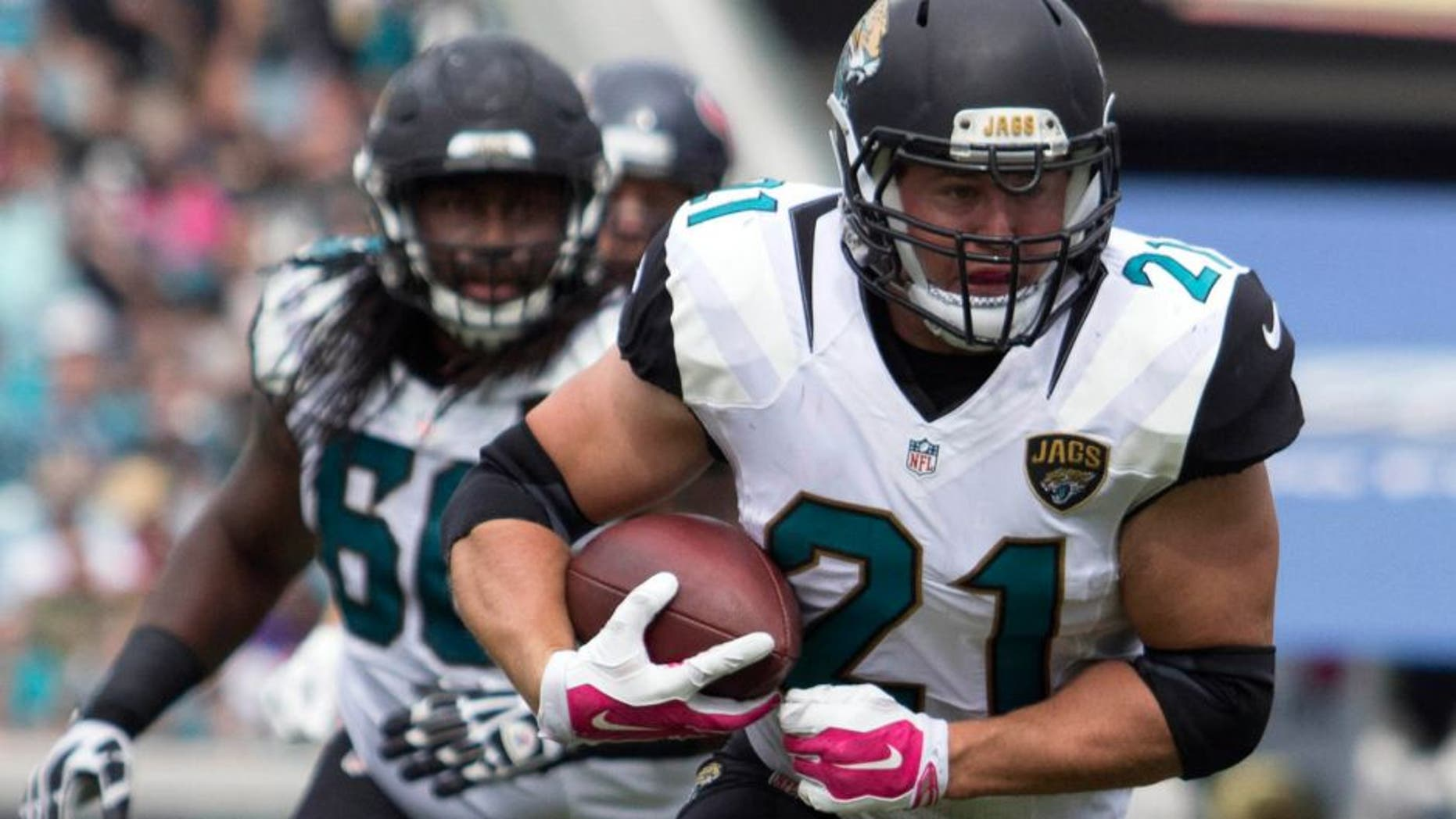 Oct 18, 2015; Jacksonville, FL, USA; Jacksonville Jaguars running back Toby Gerhart (21) runs during the second quarter against the Houston Texans at EverBank Field. Mandatory Credit: Logan Bowles-USA TODAY Sports