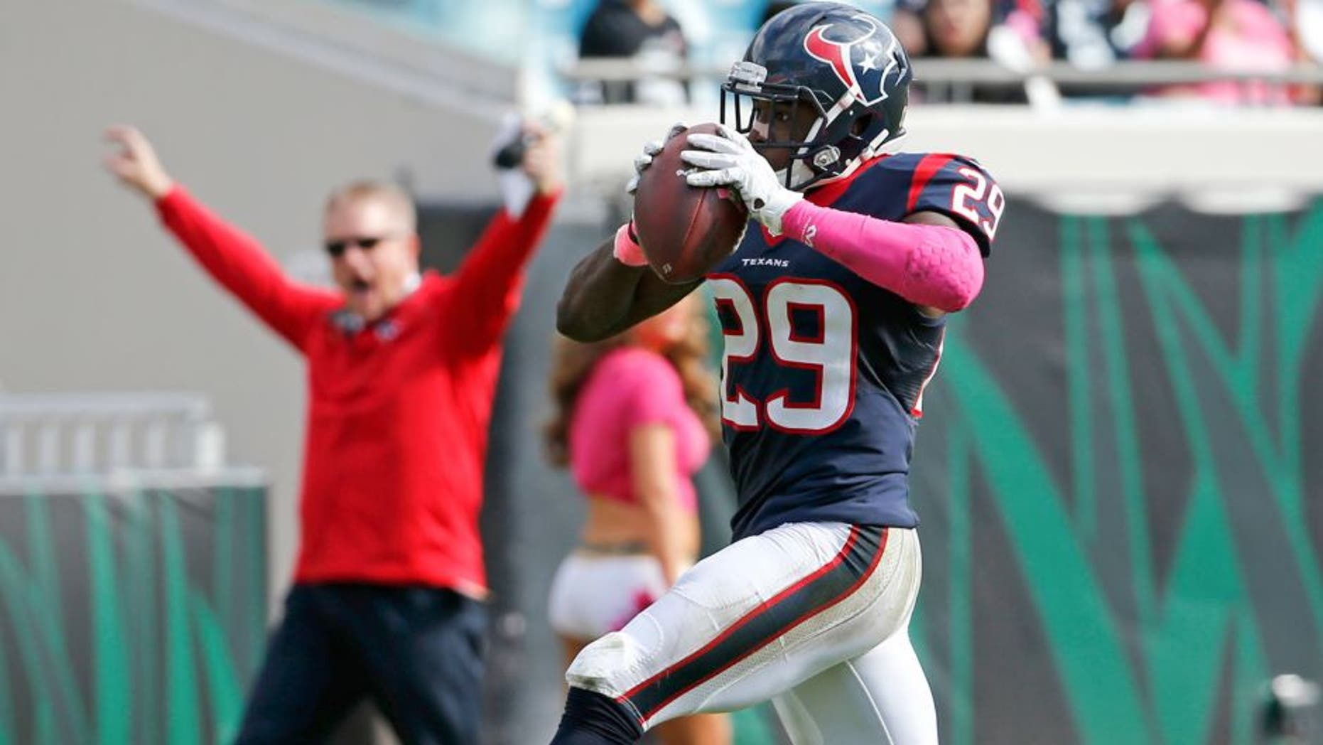 Houston Texans defensive back Andre Hal (29) returns an interception 31-yards for a touchdown against the Jacksonville Jaguars during the second half of an NFL football game in Jacksonville, Fla., Sunday, Oct. 18, 2015. (AP Photo/Stephen B. Morton)
