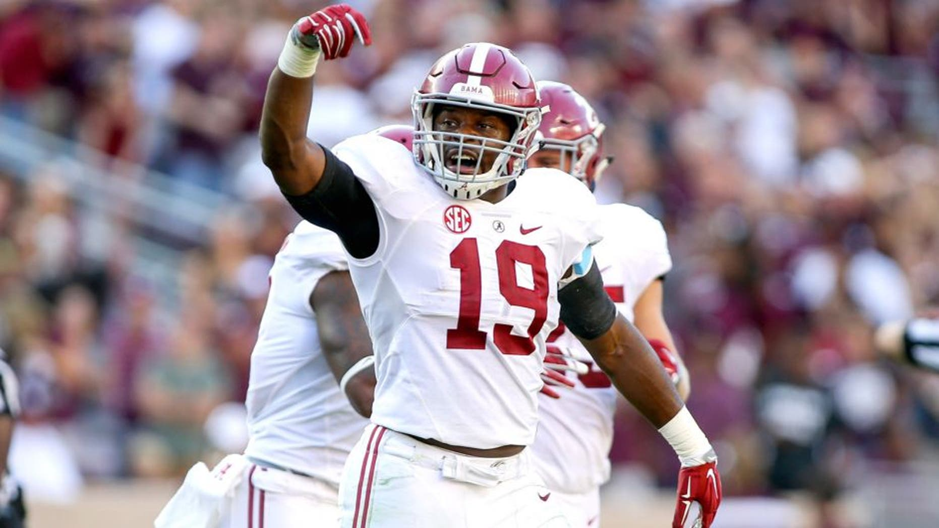 Oct 17, 2015; College Station, TX, USA; Alabama Crimson Tide linebacker Reggie Ragland (19) reacts after a play during the third quarter against the Texas A&M Aggies at Kyle Field. The Crimson Tide defeated the Aggies 41-23. Mandatory Credit: Troy Taormina-USA TODAY Sports