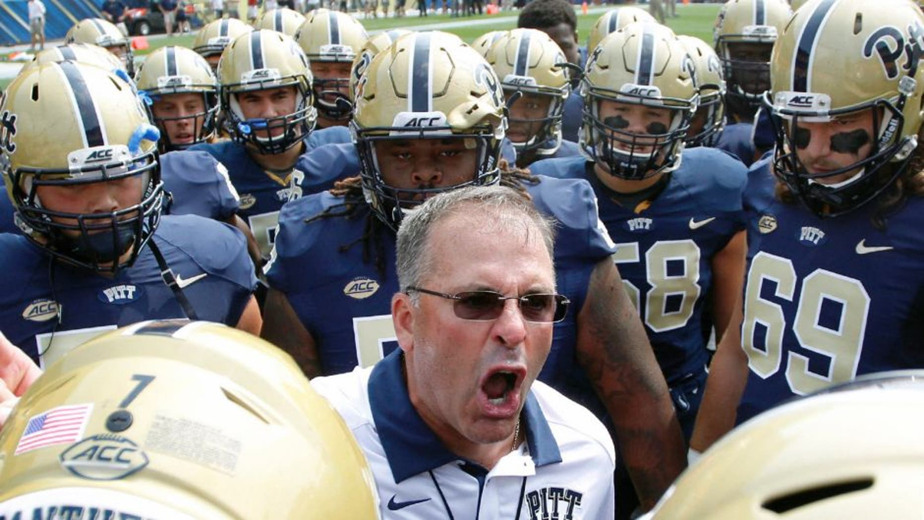 Sep 5, 2015; Pittsburgh, PA, USA; Pittsburgh Panthers head coach Pat Narduzzi (C) talks to his team prior to their game against the Youngstown State Penguins at Heinz Field. Mandatory Credit: Charles LeClaire-USA TODAY Sports