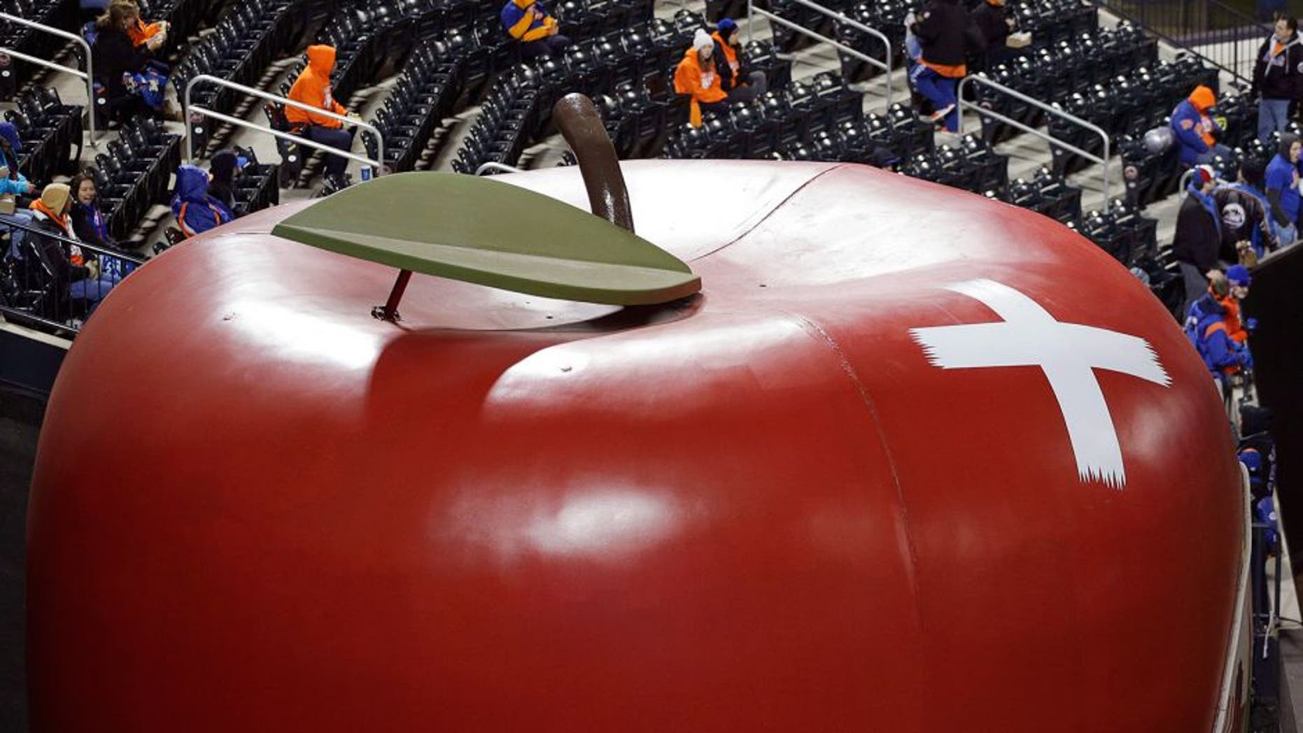 The giant apple in center field of Citi Field is seen with a bandage on it after a home run in the first game of National League baseball championship series between the New York Mets and the Chicago Cubs Sunday, Oct. 18, 2015, in New York. (AP Photo/Julie Jacobson)