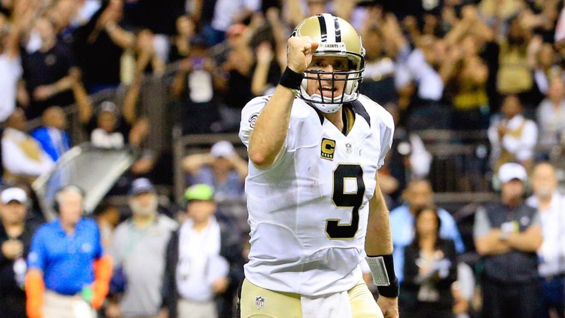 Oct 15, 2015; New Orleans, LA, USA; New Orleans Saints quarterback Drew Brees (9) celebrates after a touchdown run by running back Mark Ingram (not pictured) during the fourth quarter of a game at the Mercedes-Benz Superdome. Mandatory Credit: Derick E. Hingle-USA TODAY Sports
