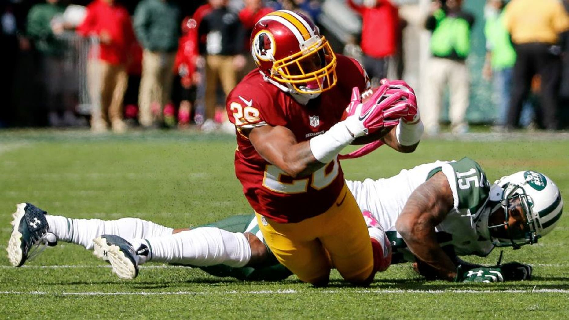 Oct 18, 2015; East Rutherford, NJ, USA; Washington Redskins cornerback Bashaud Breeland (26) intercepts a pass in the second quarter against the New York Jets at MetLife Stadium. Mandatory Credit: Vincent Carchietta-USA TODAY Sports