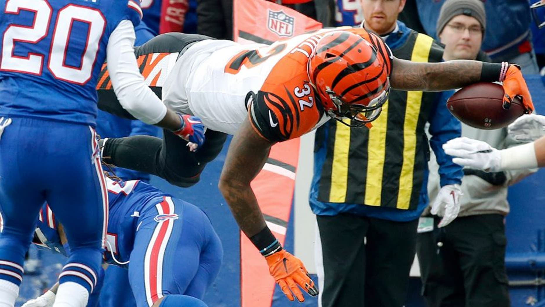 Cincinnati Bengals running back Jeremy Hill (32) dives past Buffalo Bills defenders for a touchdown during the first half of an NFL football game on Sunday, Oct. 18, 2015, in Orchard Park, N.Y. (AP Photo/Bill Wippert)