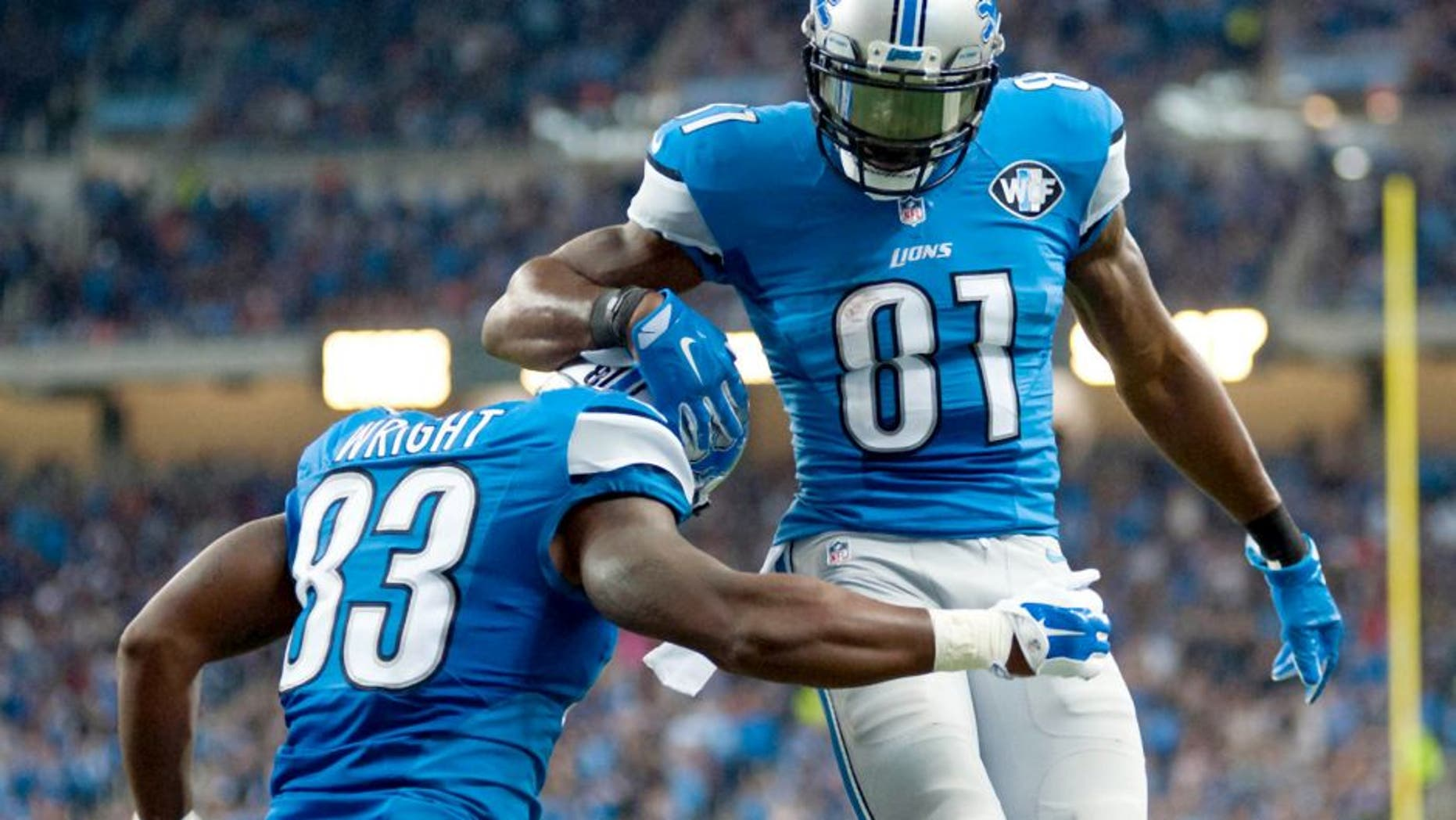 Oct 18, 2015; Detroit, MI, USA; Detroit Lions tight end Timothy Wright (83) celebrates his touchdown with wide receiver Calvin Johnson (81) during the second quarter against the Chicago Bears at Ford Field. Mandatory Credit: Tim Fuller-USA TODAY Sports